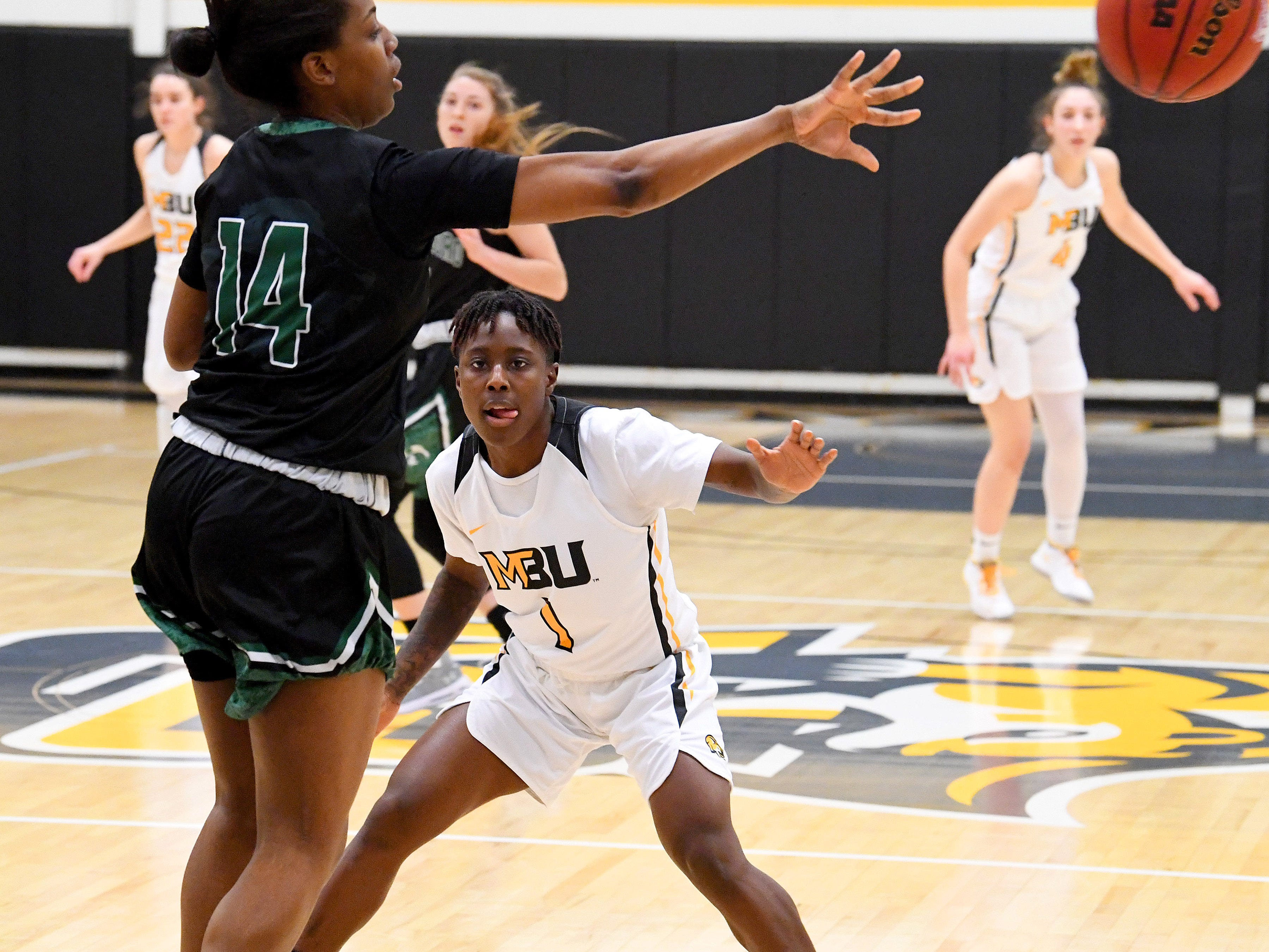 Mary Baldwin's Yaya Nedd guards against Greensboro's Sabria Joseph who passes the ball during a USA South conference game played in Staunton on Jan. 9, 2019.