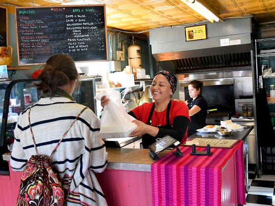 Co-owner Gloria Gerber (right) assists a customer at the front counter inside the newly expanded Glora's Pupuseria in Staunton on Thursday, Jan. 10, 2019. Gloria co-owns the El Salvadorian restaurant with her husband, John Gerber.