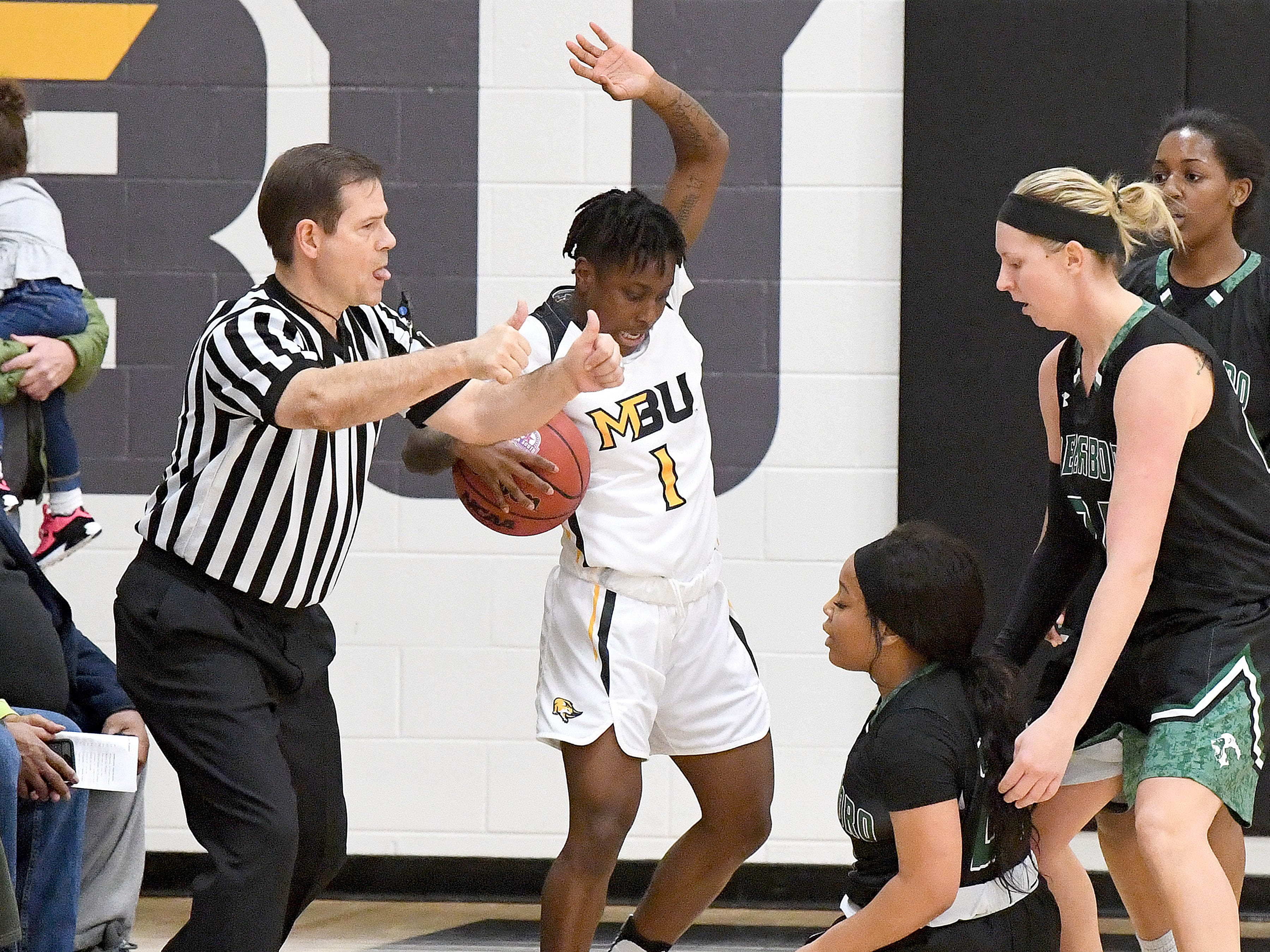 Mary Baldwin's Yaya Nedd comes away with the alternating possession call after challenging a Greensboro player for possession during a USA South conference game played in Staunton on Jan. 9, 2019.