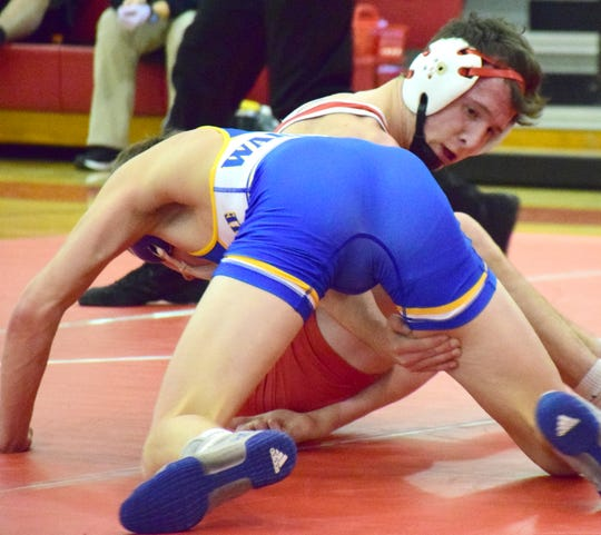 Riverheads' G.W. Shultz works for a reversal against Western Albemarle's Beighley Austin during their 126-pound bout at the Riverheads quad on Wednesday, Jan. 9, 2019, in high school wrestling action at Riverheads High School in Greenville, Va.