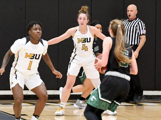 Mary Baldwin's Yaya Nedd and Nicole Blackburn guard against Greensboro's Katie Lewis during a USA South conference game played in Staunton on Jan. 9, 2019.