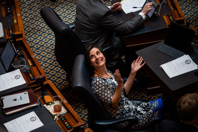 Del. Jennifer Boysko, D-Fairfax, claps during the opening of the 2019 session of the Virginia General Assembly in the House chambers at the state Capitol in Richmond on Wednesday, Jan. 9, 2019.