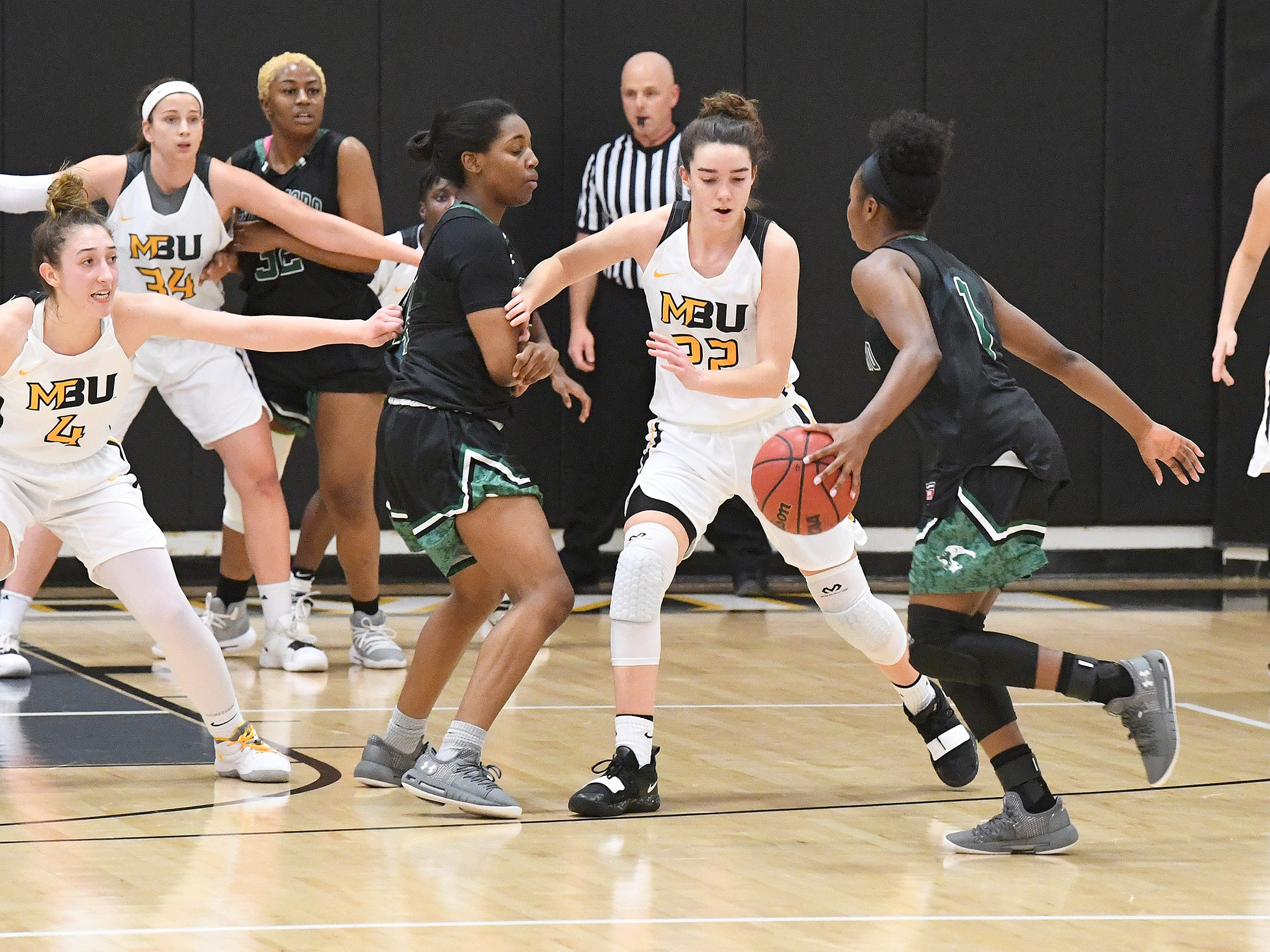 Mary Baldwin's Leah Calhoun (#22) guards against Greensboro's Ashley Free (#1) during a USA South conference game played in Staunton on Jan. 9, 2019.