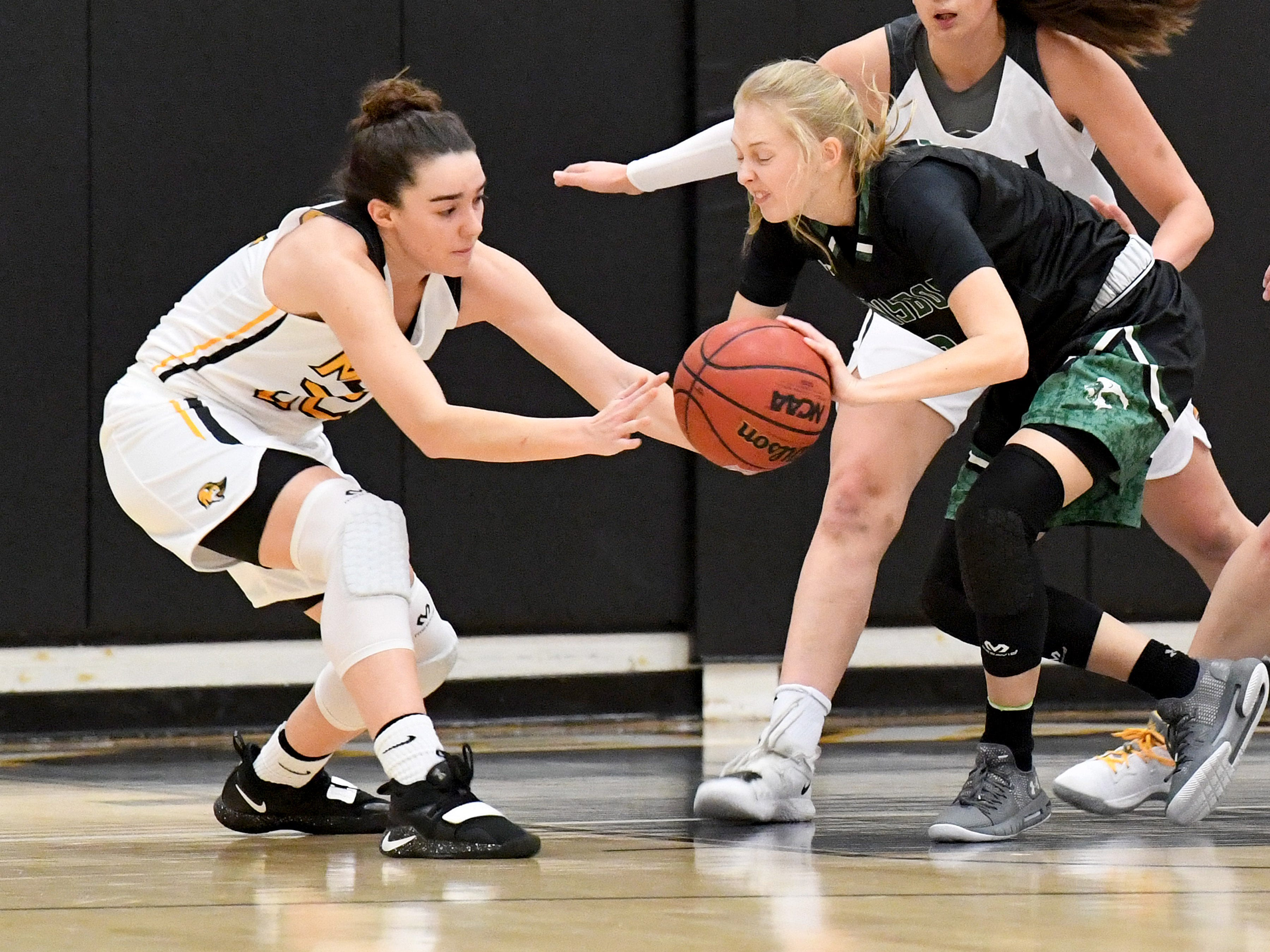 Mary Baldwin's Leah Calhoun (left) slips in to take the ball from Greensboro's Nyla Issac during a USA South conference game played in Staunton on Jan. 9, 2019.