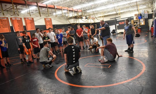 Coach Bob Boeck talks to team members during practice Wednesday, Jan. 9, at Tech High School in St. Cloud.