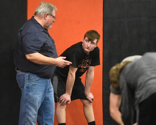 Tyler Zachman talks with coach Bob Boeck during practice Wednesday, Jan. 9, at Tech High School in St. Cloud.
