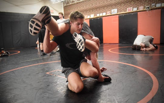 Jack Latterell lifts his opponent during practice Wednesday, Jan. 9, at Tech High School in St. Cloud.
