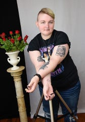 "Grace Duxbury, museum assistant, shows her tattoos Wednesday, Jan. 9, for a new exhibit called ""The Story Behind the Tat: Tattoo Art in Central Minnesota"" at the Charles A. Weyerhaeuser Memorial Museum in Little Falls."