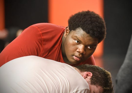 Carlos Agee of Apollo concentrates on his opponent during practice Wednesday, Jan. 9, at Tech High School in St. Cloud.