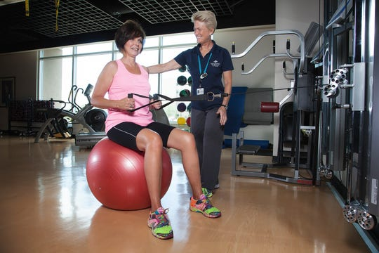 Kinesiologist Hannah Rothlin supports Janet Reber as she performs a core strength exercise at Intermountain Healthcare's LiVe Well Center in St. George.