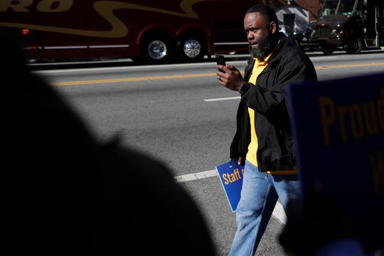 Ray Coleman, Federal Correctional Institution union president, records the rally formed by members of the union in front of the Federation of Labor and Congress of Industrial Organizations (AFL-CIO) building in Tallahassee before marching to the Florida Historic Capitol in protest of the government shutdown Thursday, Jan. 10, 2019.