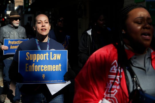 Federal Correctional Institution worker Nicole Trawick marches with her fellow federal workers as they protest against the government shutdown in downtown Tallahassee Thursday, Jan. 10, 2019. Several dozen employees of the federal government marched from the Federation of Labor and Congress of Industrial Organizations (AFL-CIO) building to the Florida Historic Capitol in protest of the government shutdown and the fact that some of them, like Trawick, are working without pay.