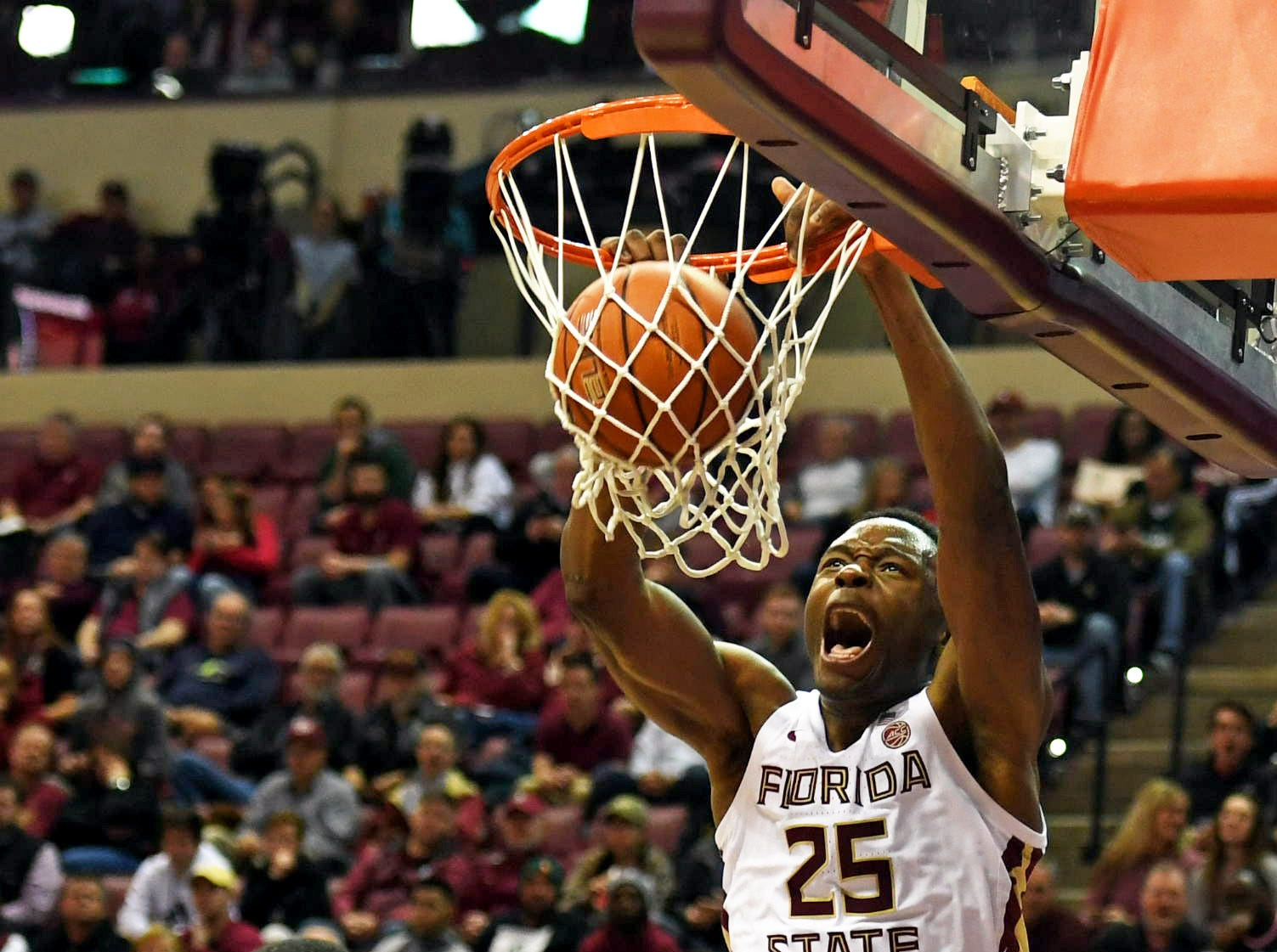 Jan 9, 2019; Tallahassee, FL, USA;  Florida State Seminoles forward Mfiondu Kabengele (25) dunks the ball against Miami Hurricanes guard Anthony Lawrence II (3)  during the first half at Donald L. Tucker Center. Mandatory Credit: Melina Myers-USA TODAY Sports