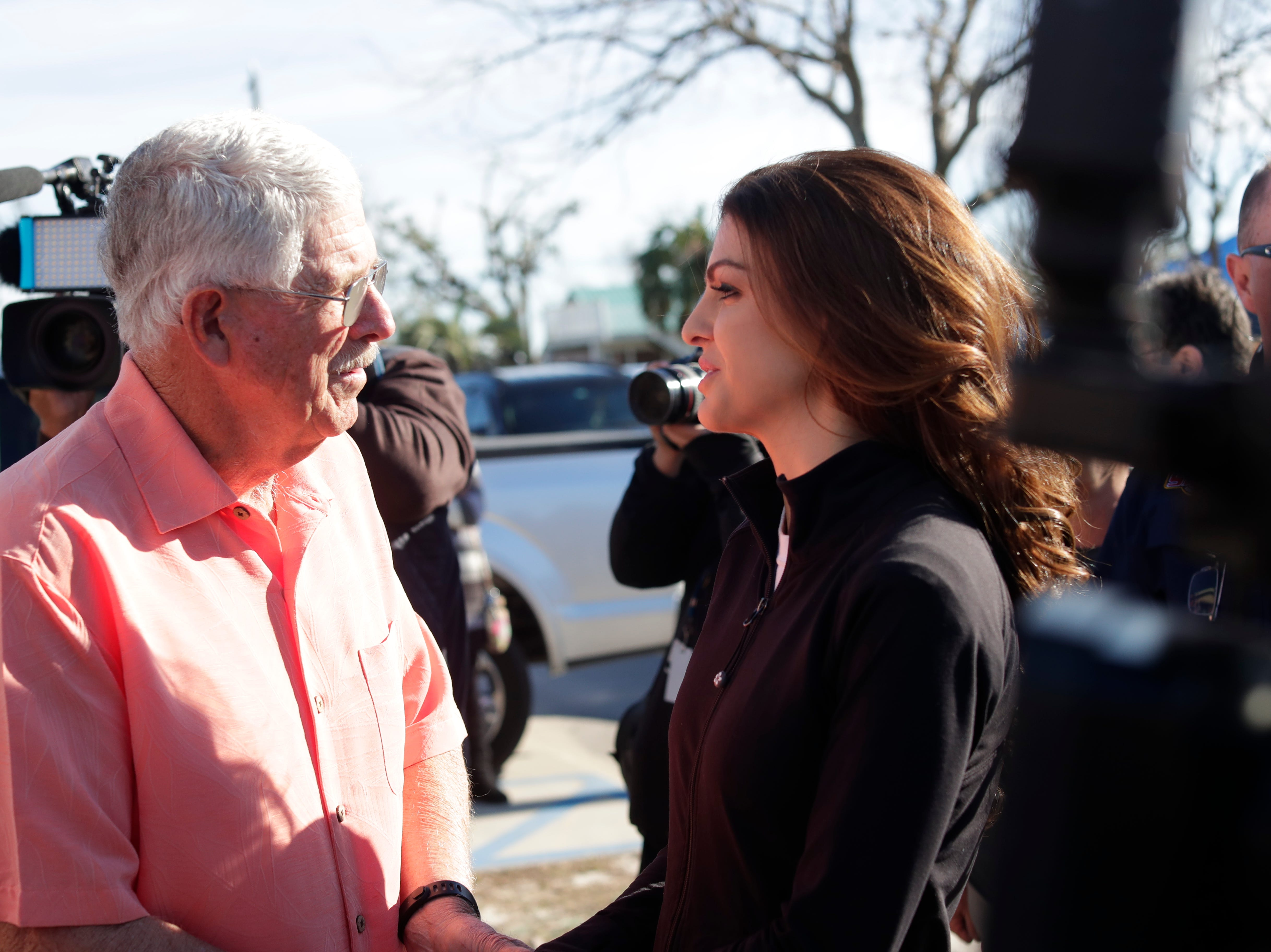 First lady Casey DeSantis, right, is greeted by the Mexico Beach Mayor Al Cathey, before touring the city Wednesday, Jan. 9, 2019. Hurricane Michael left the panhandle in a total disarray on Oct. 10, 2018.