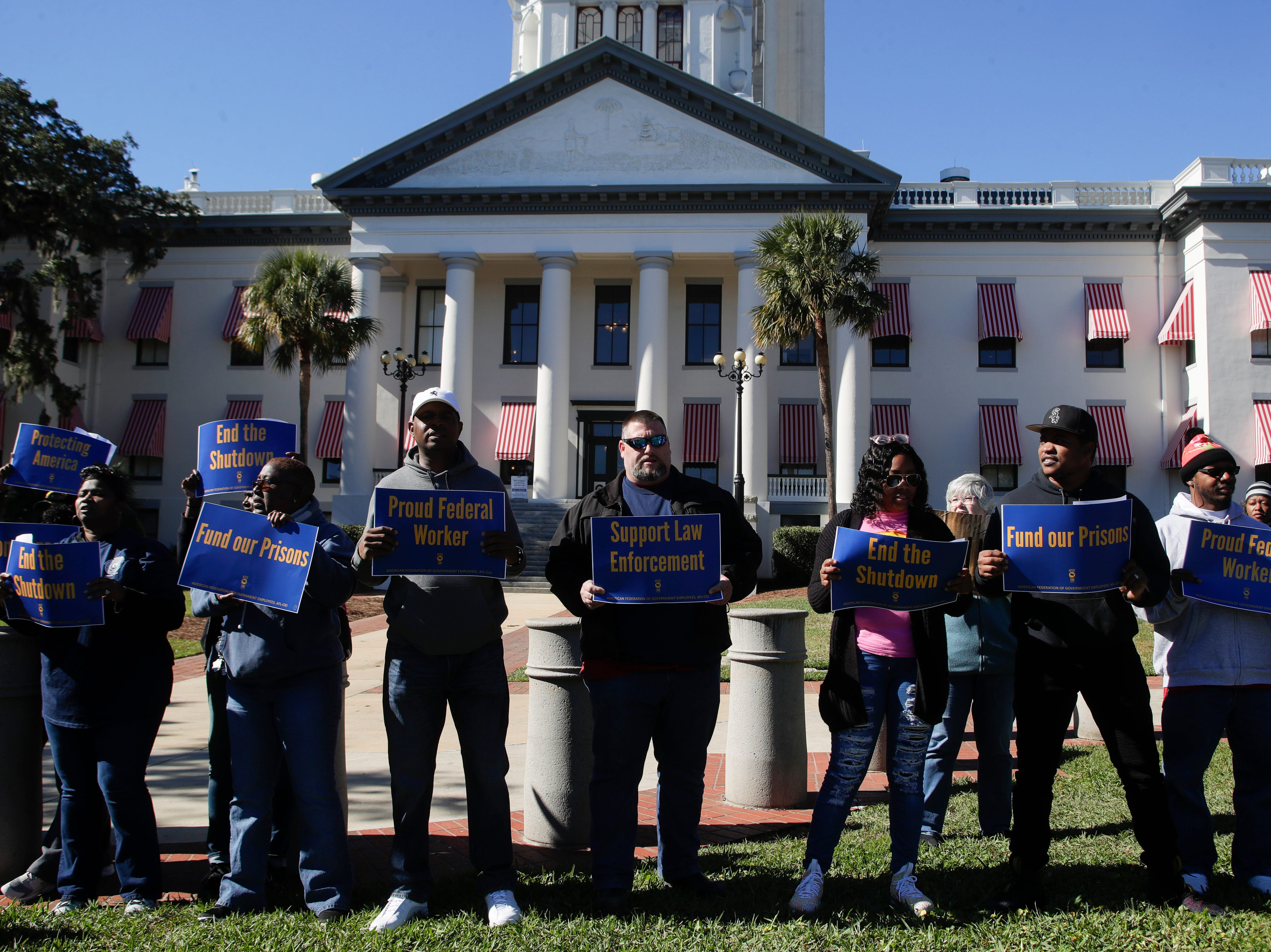 Federal workers rallied and marched from the American Federation of Labor and Congress of Industrial Organizations (AFL-CIO) building in Tallahassee to the Florida Historic Capitol in protest of the government shutdown Thursday, Jan. 10, 2019.