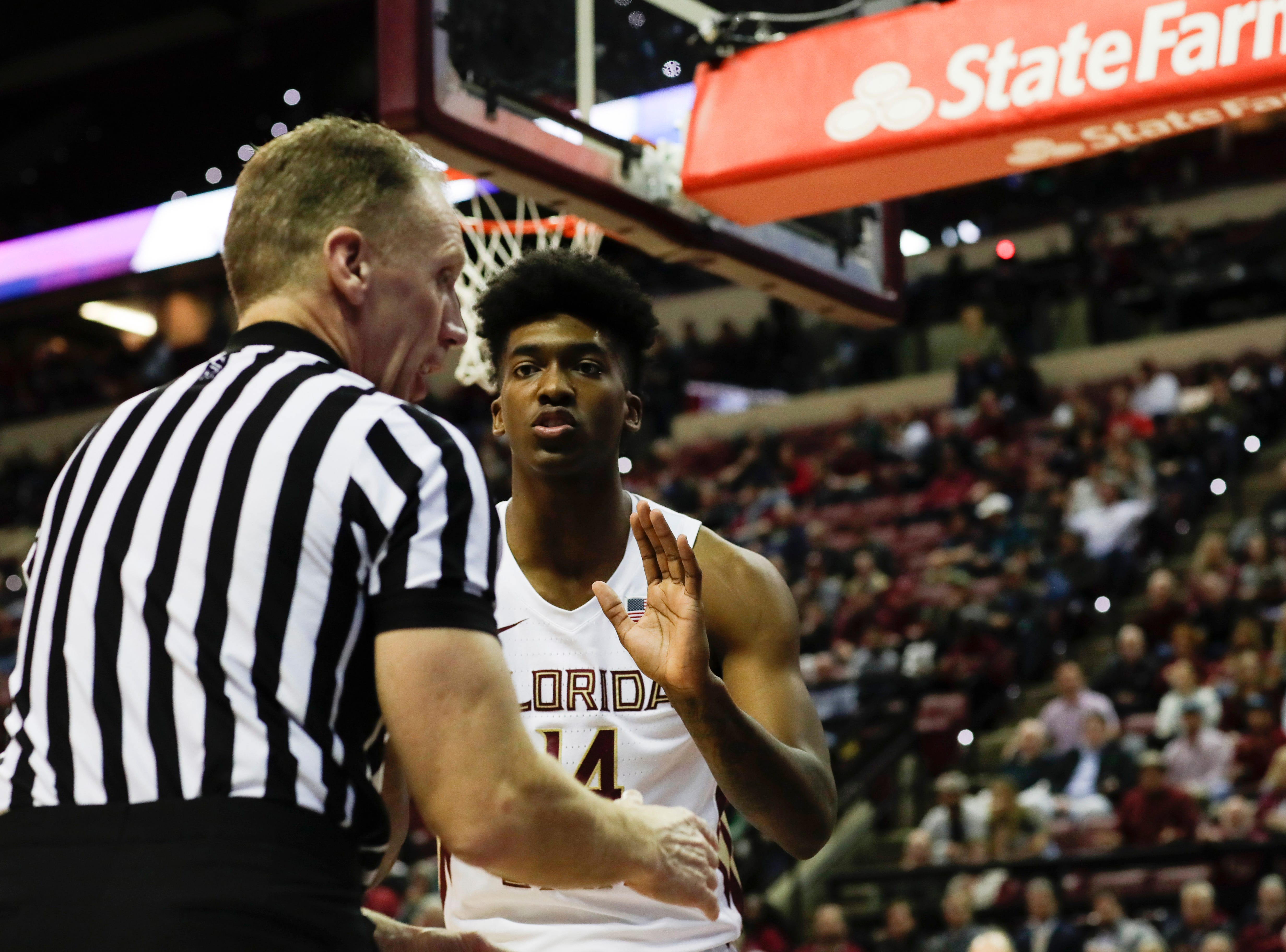 Florida State Seminoles guard Terance Mann (14) pleads with a referee after a call against his team during a game between FSU and University of Miami Wednesday, Jan. 9, 2019.