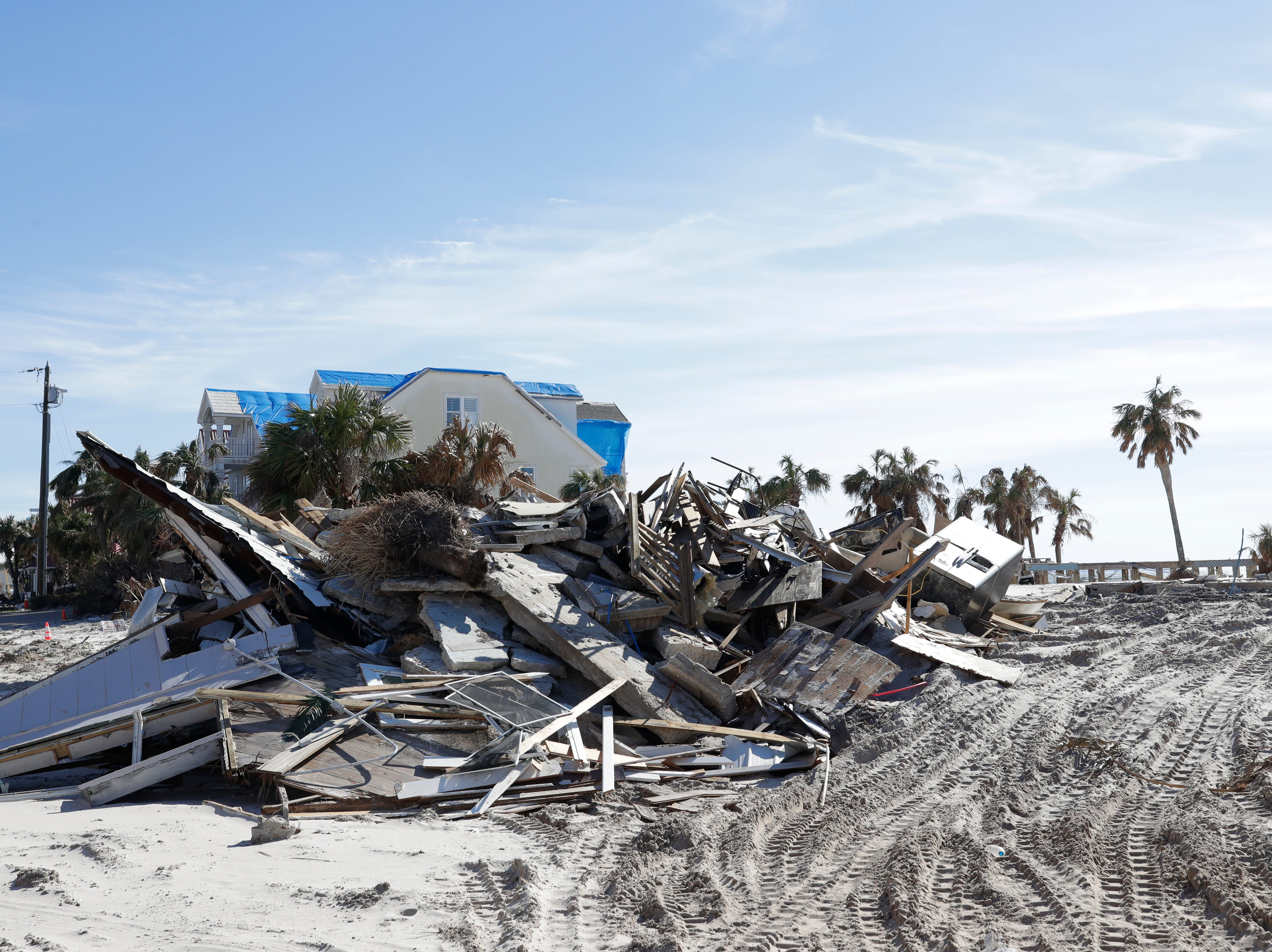 Piles of debris line the streets of Mexico beach, Wednesday, Jan. 9, 2019. Hurricane Michael left the panhandle in a total disarray on Oct. 10, 2018.