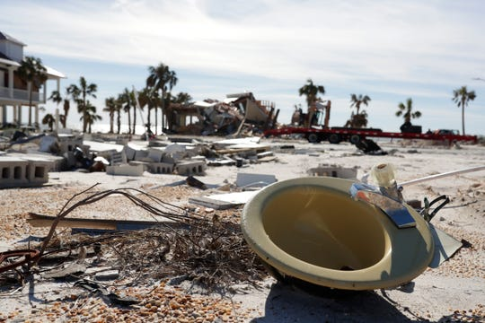 A sink rests amongst other debris covering the waterfront in Mexico Beach, Wednesday, Jan. 9, 2019. Hurricane Michael left the panhandle in a total disarray on Oct. 10, 2018.