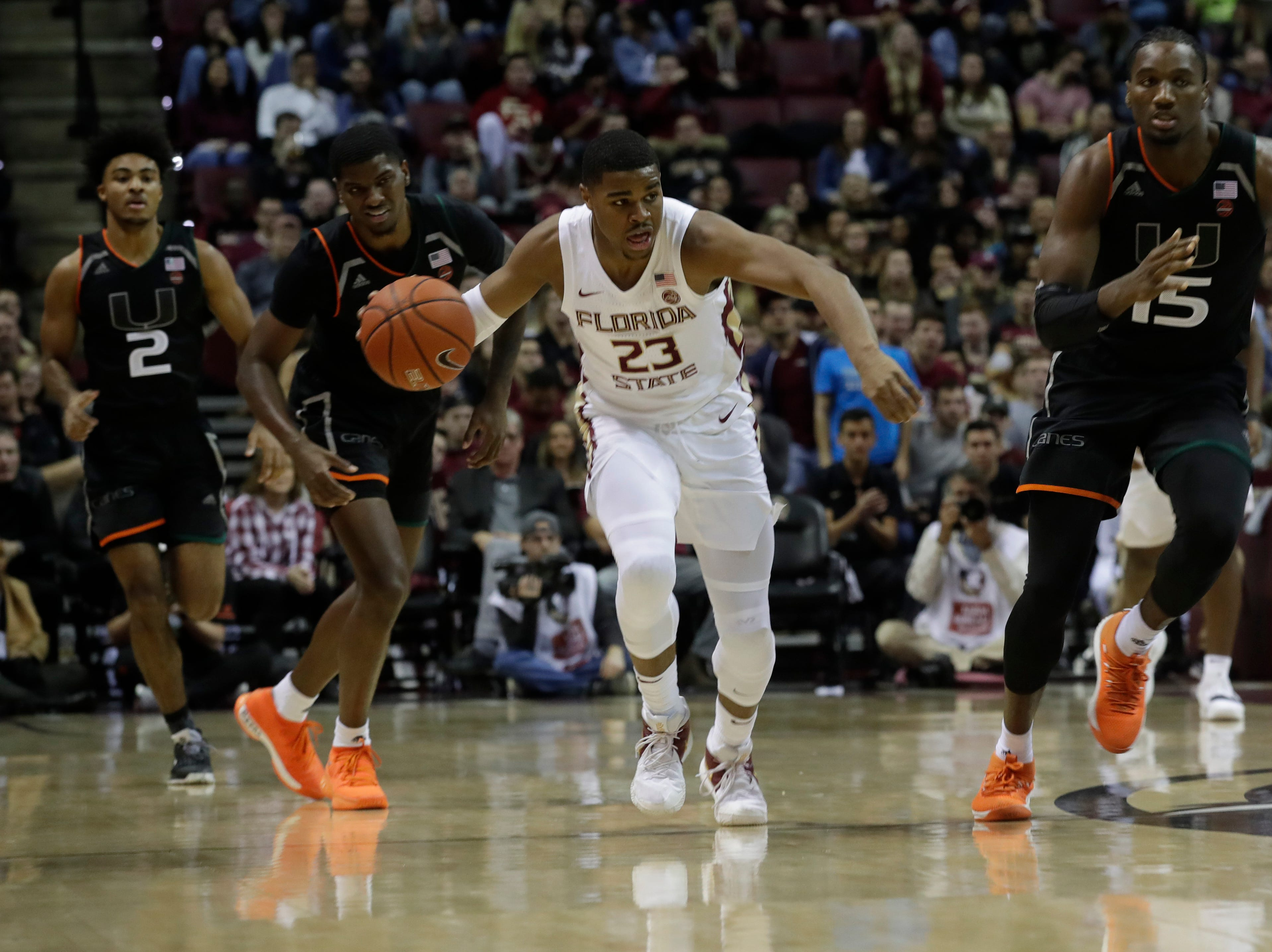 Florida State Seminoles guard M.J. Walker (23) dribbles on a breakaway during a game between FSU and University of Miami Wednesday, Jan. 9, 2019.