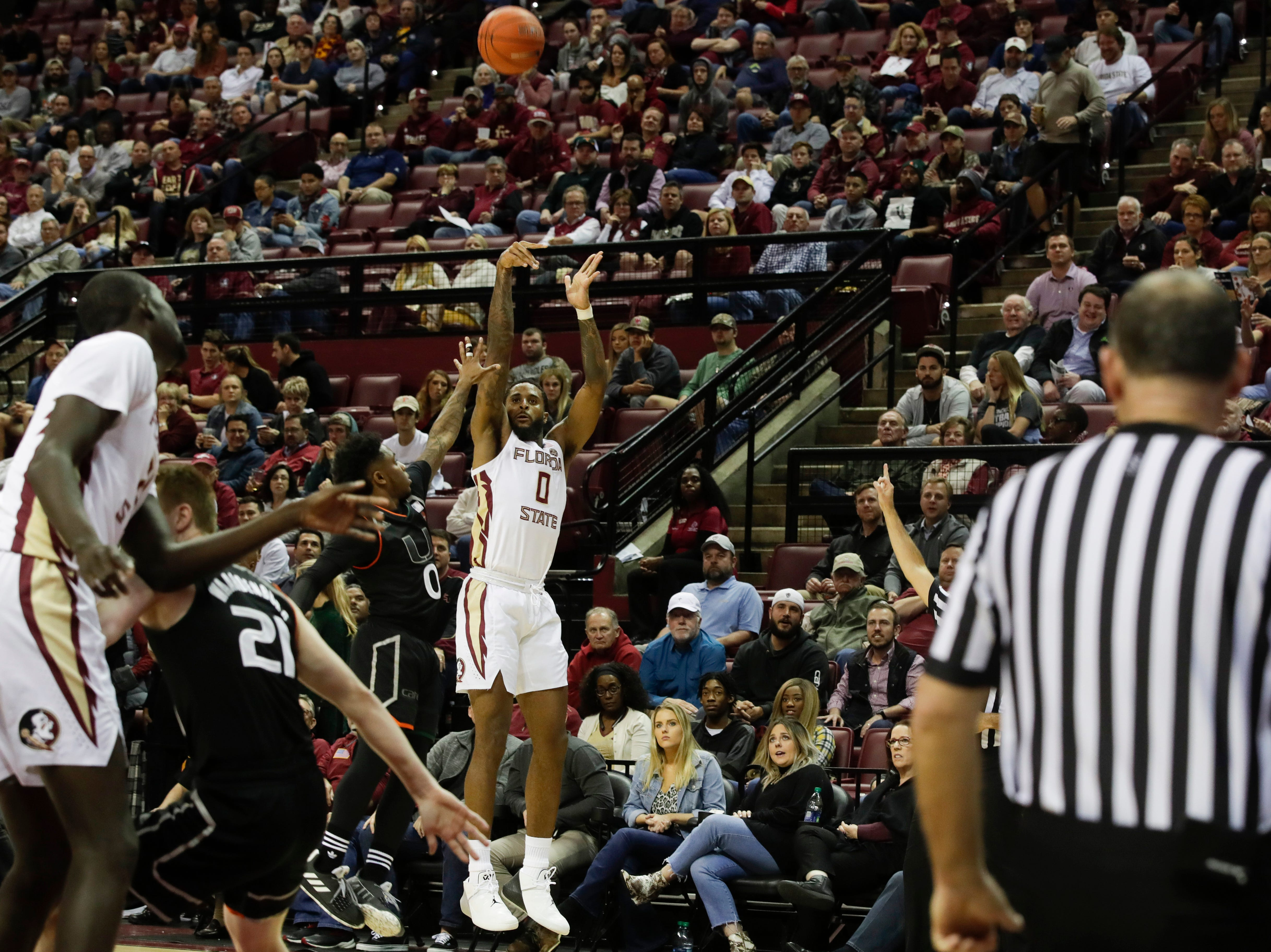 Florida State Seminoles forward Phil Cofer (0) shoots a three during a game between FSU and University of Miami Wednesday, Jan. 9, 2019.
