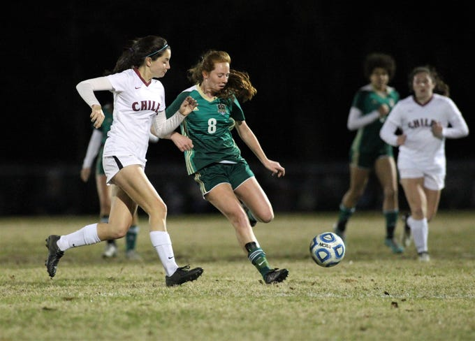 Lincoln's Rylee French and Chiles' Gabby O'Sullivan battle for possession in the midfield. Lincoln beat Chiles 2-1 on Jan. 9, 2019.