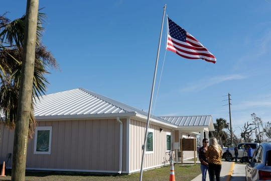 The flag pole outside city hall in Mexico Beach, leans forward, Wednesday, Jan. 9, 2019. Hurricane Michael left the panhandle in a total disarray on Oct. 10, 2018.