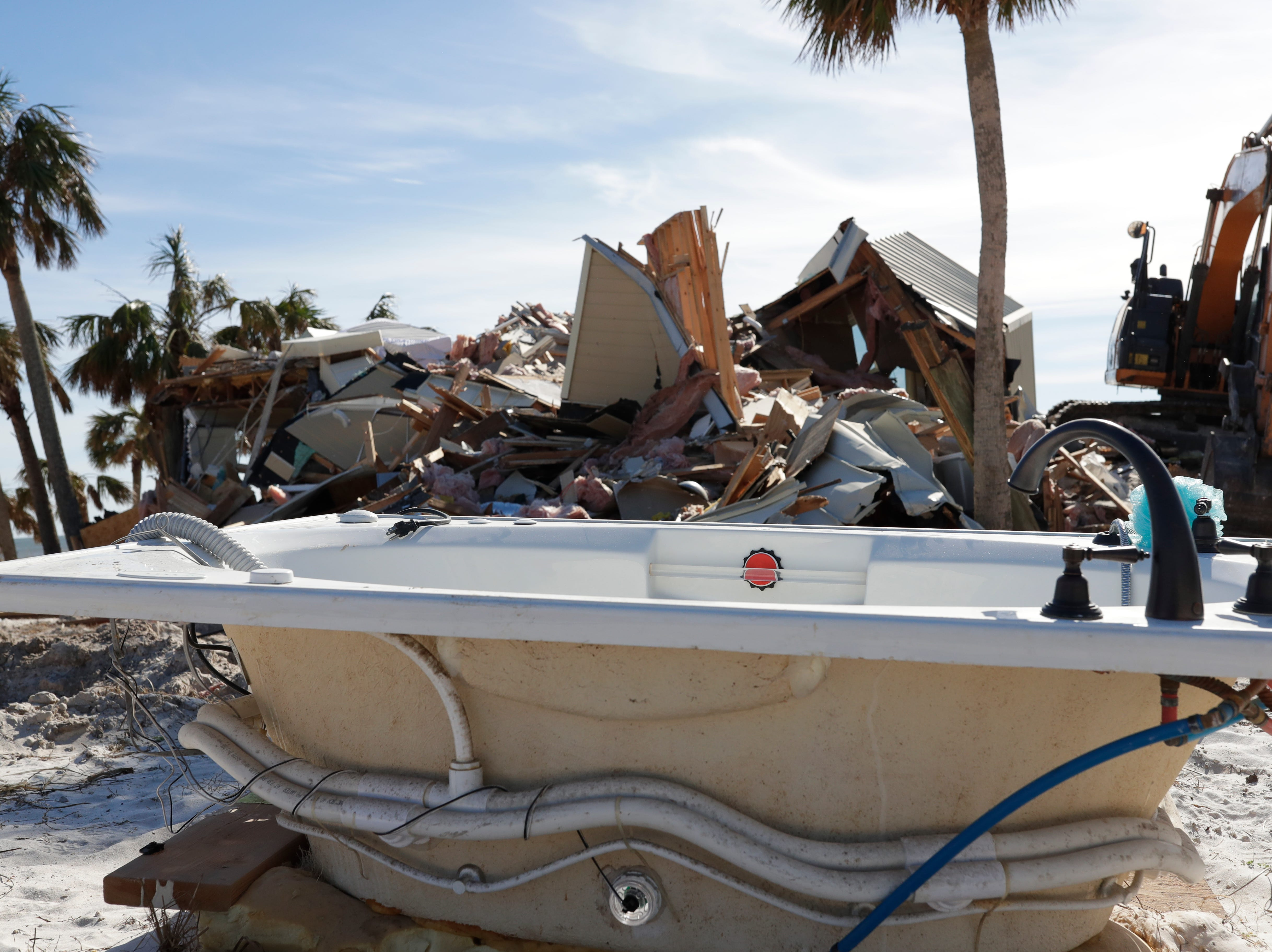 A bathtub sits in front of a pile of debris on the beachfront in Mexico Beach, Wednesday, Jan. 9, 2019. Hurricane Michael left the panhandle in a total disarray on Oct. 10, 2018.