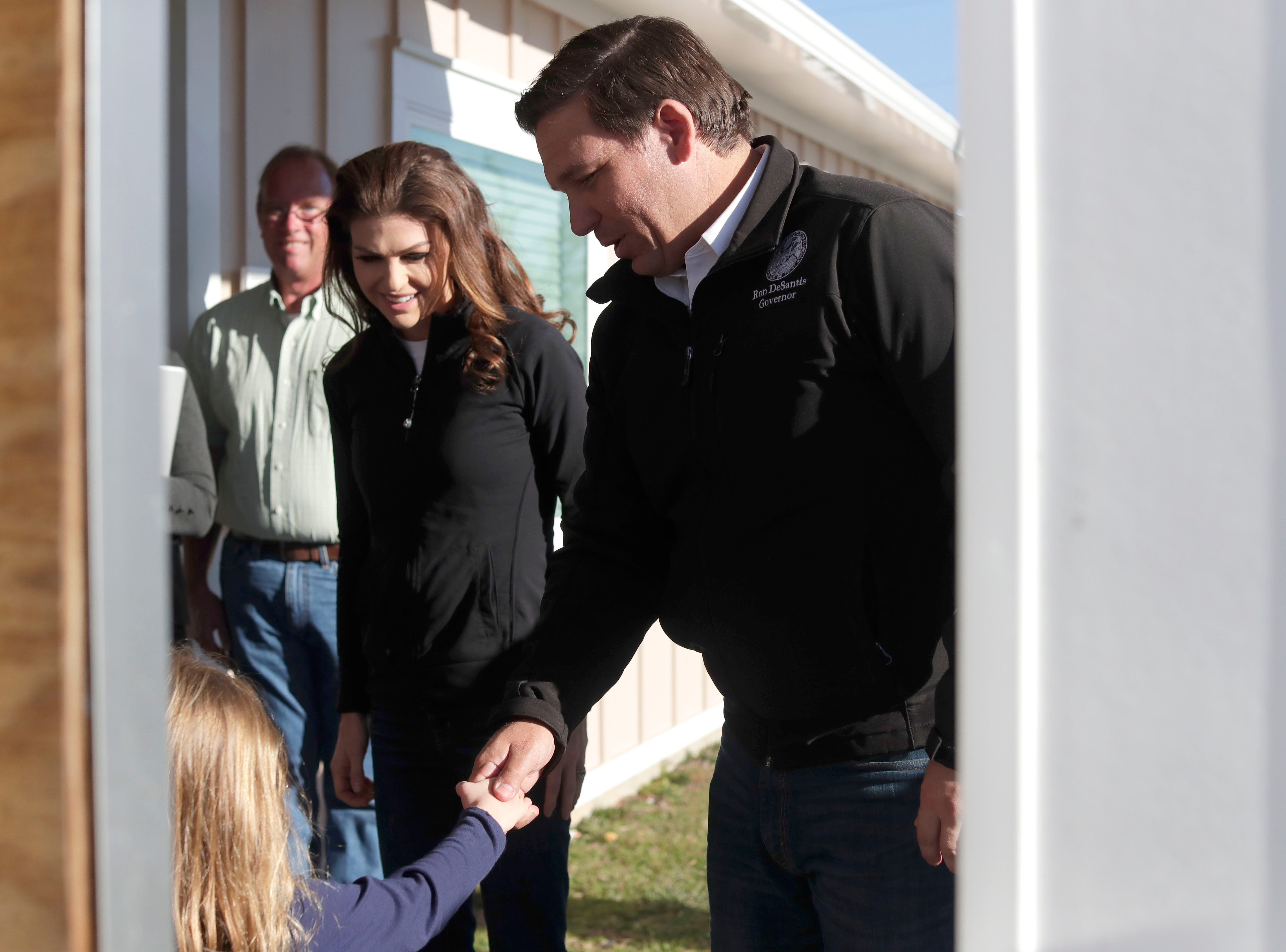 Gov. Ron DeSantis greets a young girl from Mexico Beach outside of city hall, Wednesday, Jan. 9, 2019. Hurricane Michael left the panhandle in a total disarray on Oct. 10, 2018.
