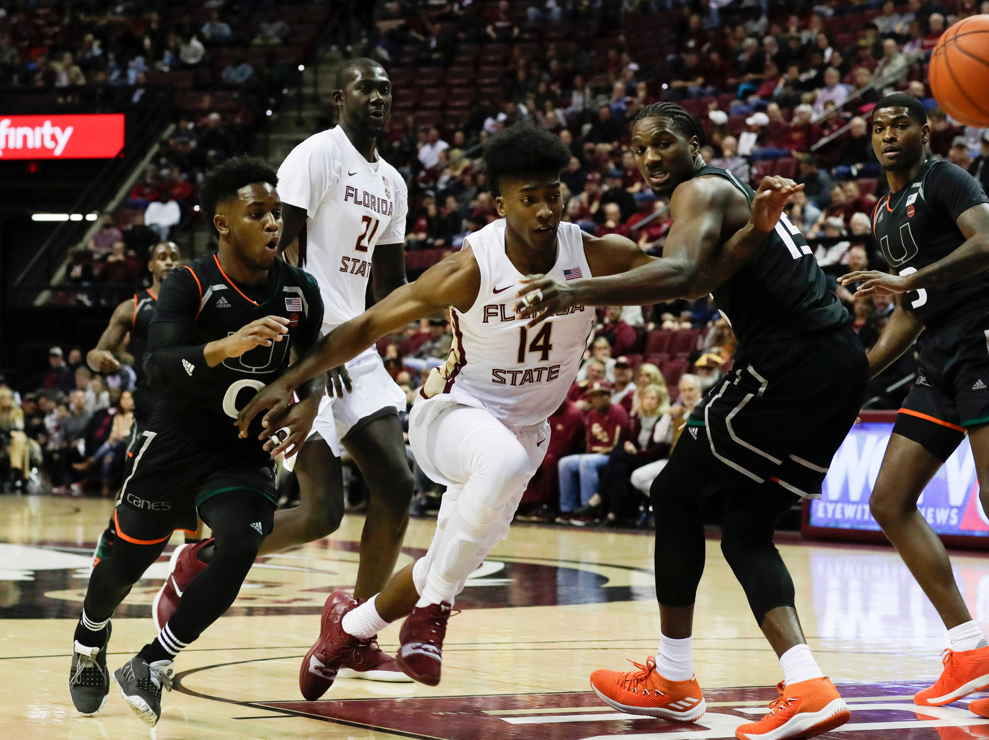 Florida State Seminoles guard Terance Mann (14) chases a loose ball during a game between FSU and University of Miami Wednesday, Jan. 9, 2019.