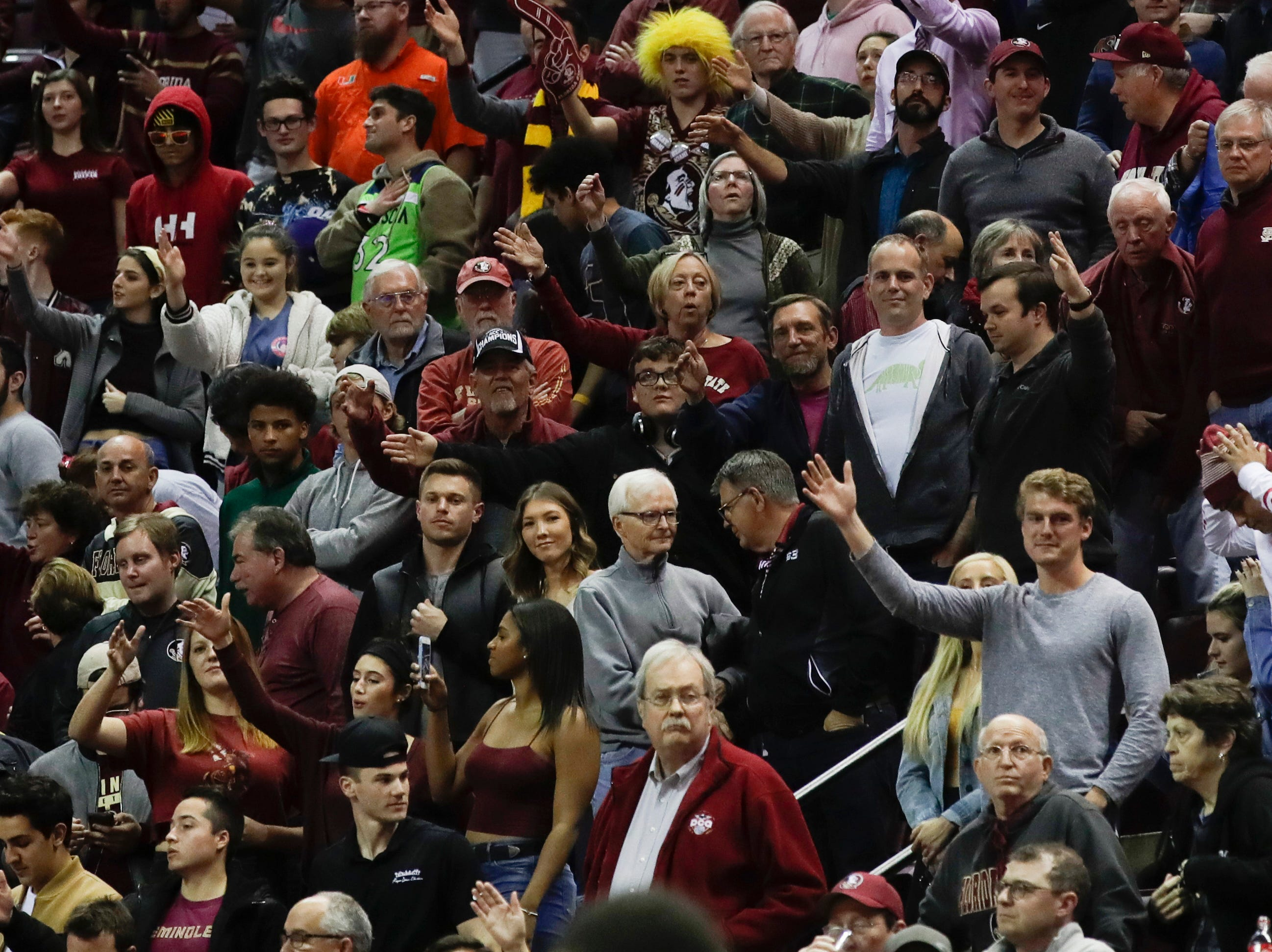 The crowd does the chop during a game between FSU and University of Miami Wednesday, Jan. 9, 2019.