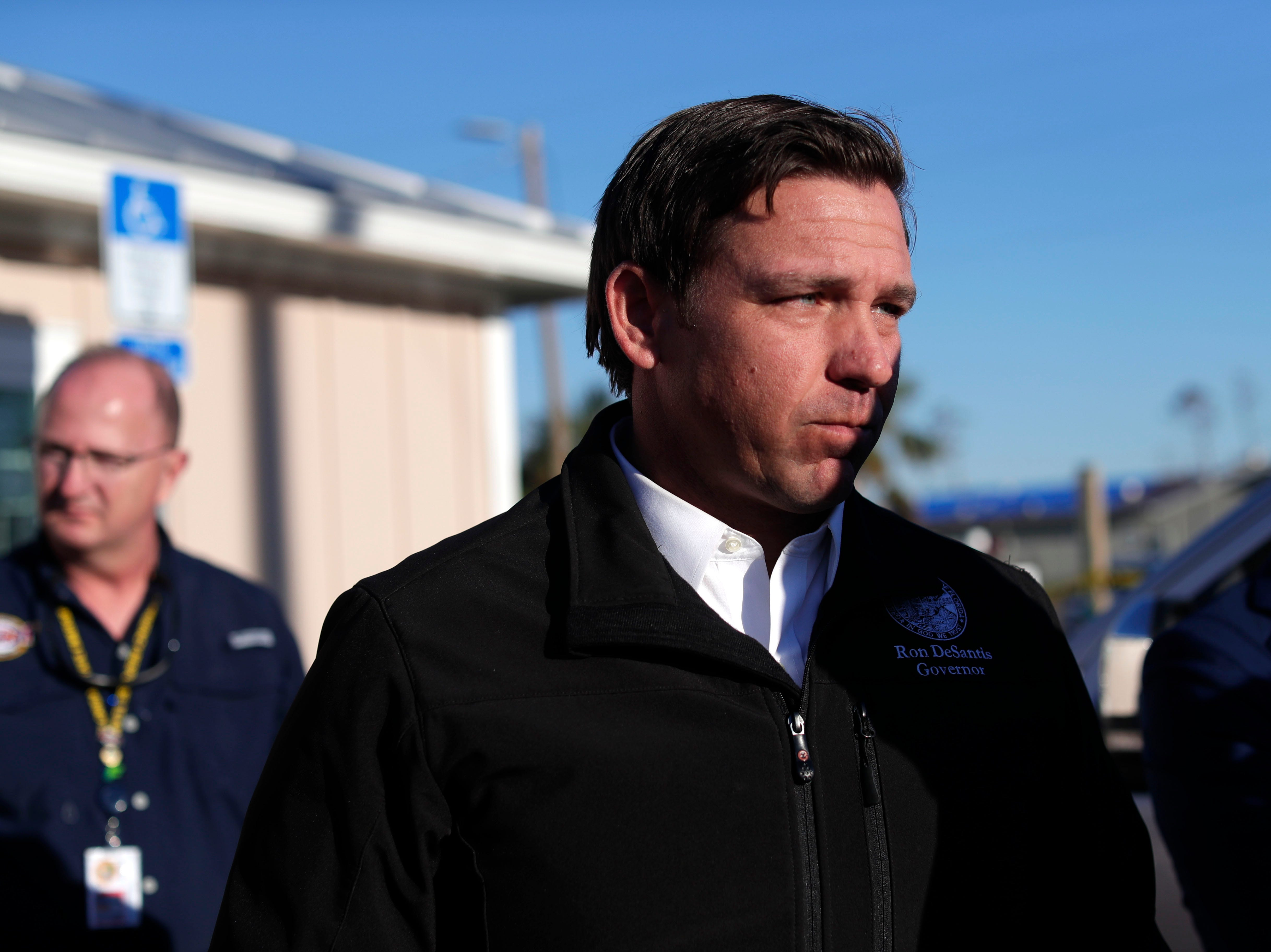 Gov. Ron DeSantis speaks with the media about what he saw when touring Mexico Beach, Jan. 9, 2019. Hurricane Michael left the panhandle in a total disarray on Oct. 10, 2018.