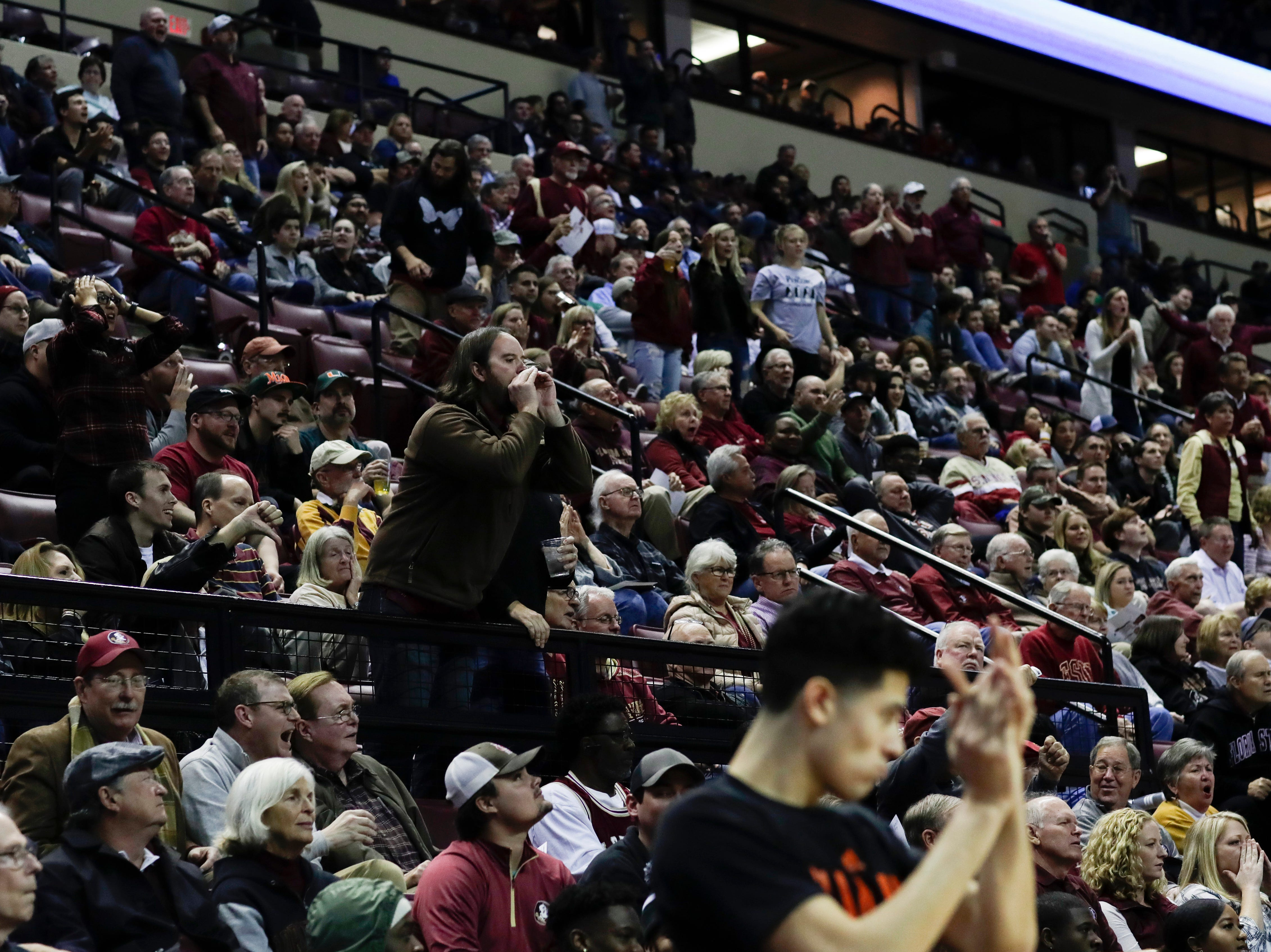 Fans react to a call against Florida State during a game between FSU and University of Miami Wednesday, Jan. 9, 2019.