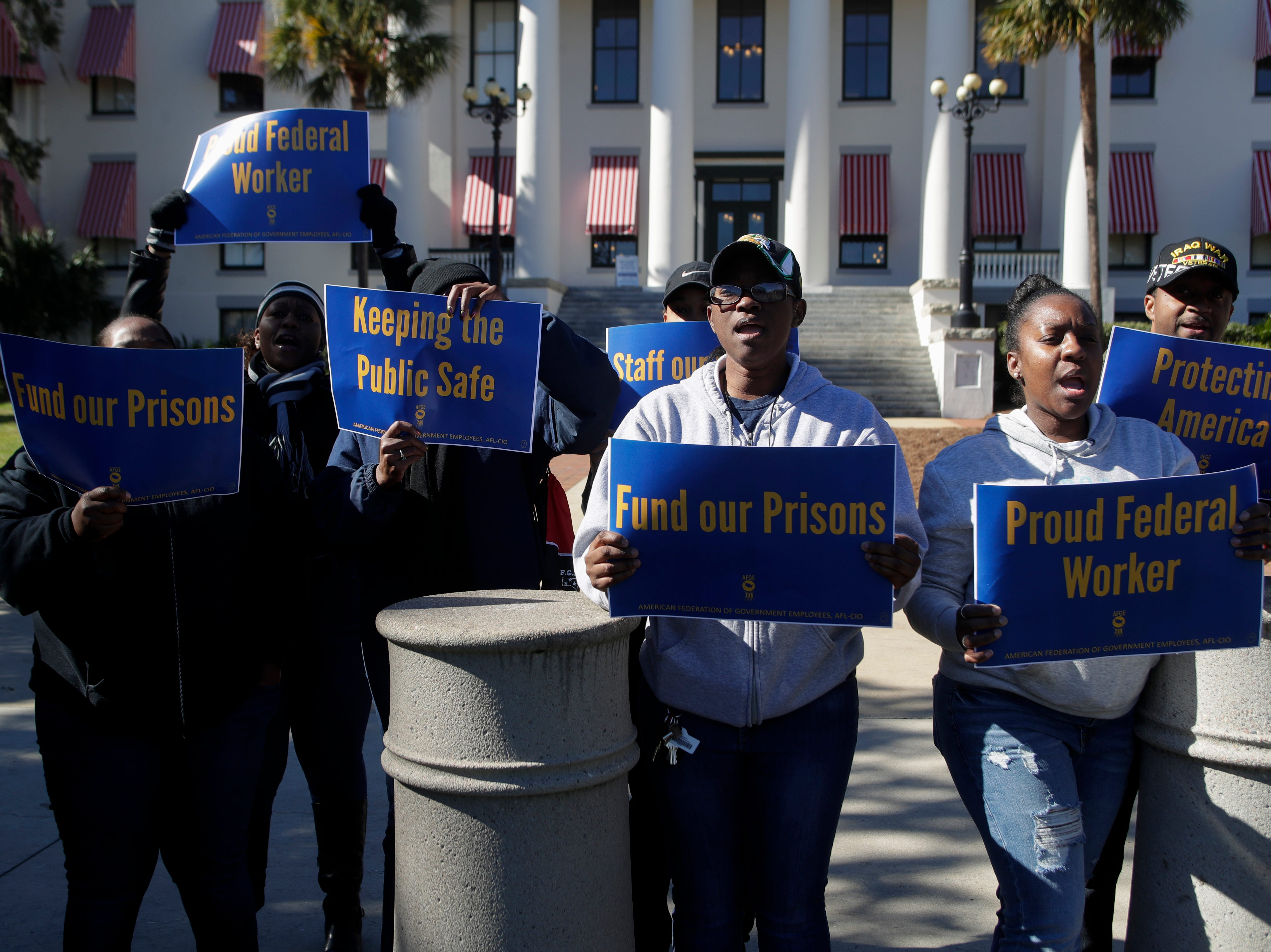 Yamira Richardson, left, and Sondra Freeman, bother Federal Correctional Institution workers protest the government shutdown with their colleagues in front of the Florida Historic Capitol Thursday, Jan. 10, 2019.