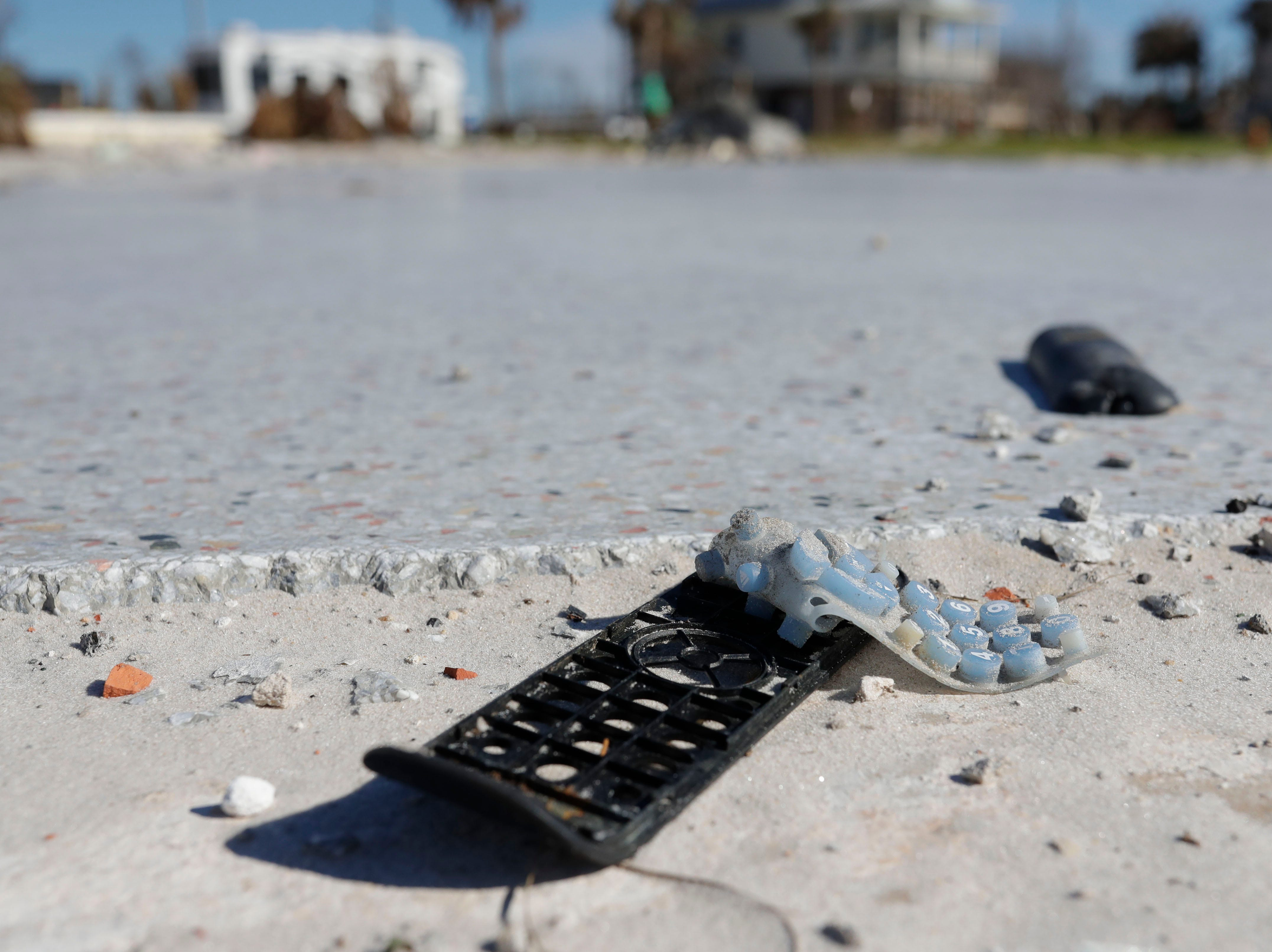 What was once a television remote is seen laying on the foundation of a home in Mexico Beach, Wednesday, Jan. 9, 2019, which was ripped away when Hurricane Michael left the panhandle in a total disarray on Oct. 10, 2018.