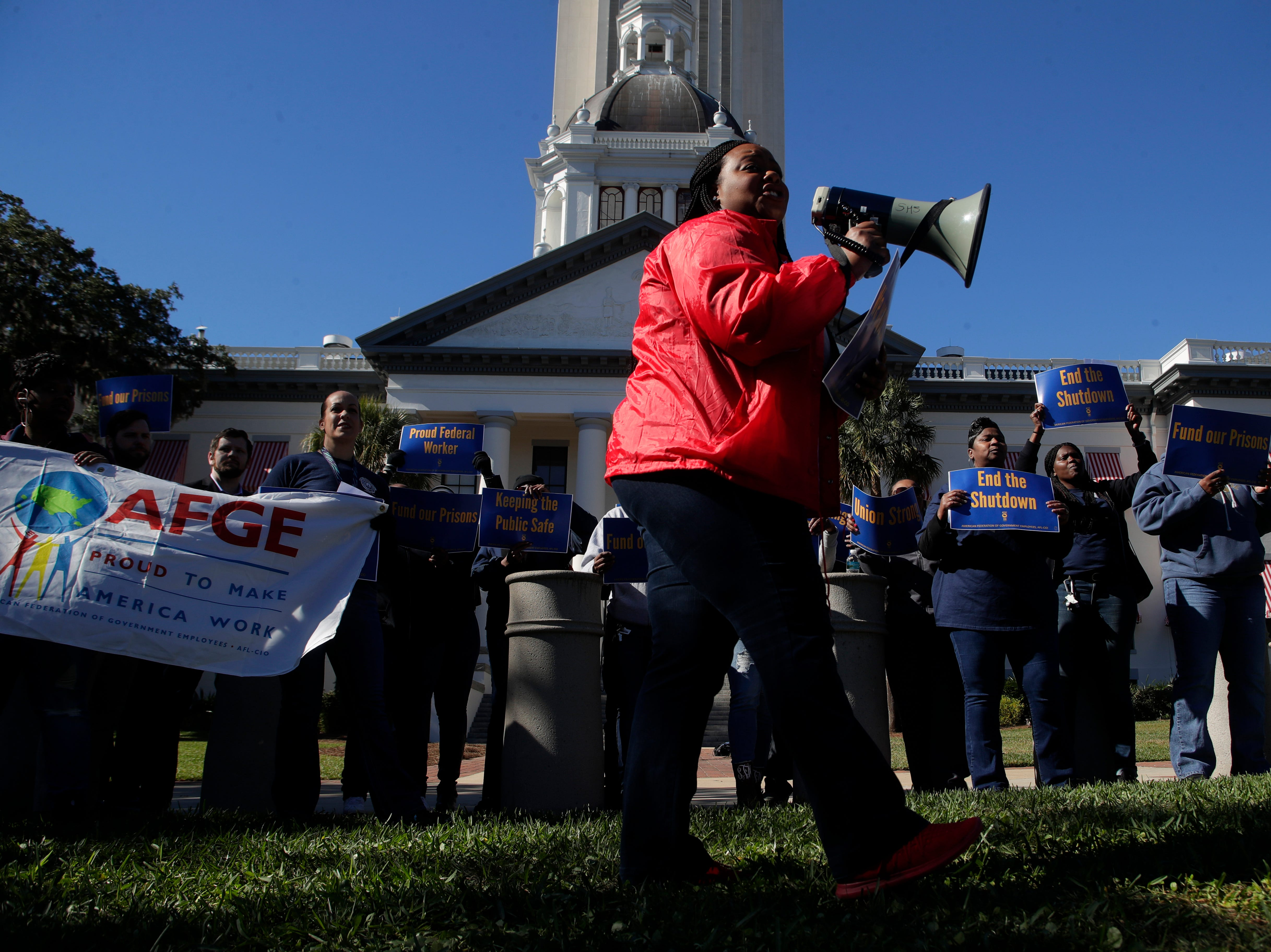 Federal Correctional Institution employee Kristan Morgan leads chants among fellow federal employees in front of the Florida Historic Capitol in protest of the government shutdown Thursday, Jan. 10, 2019.