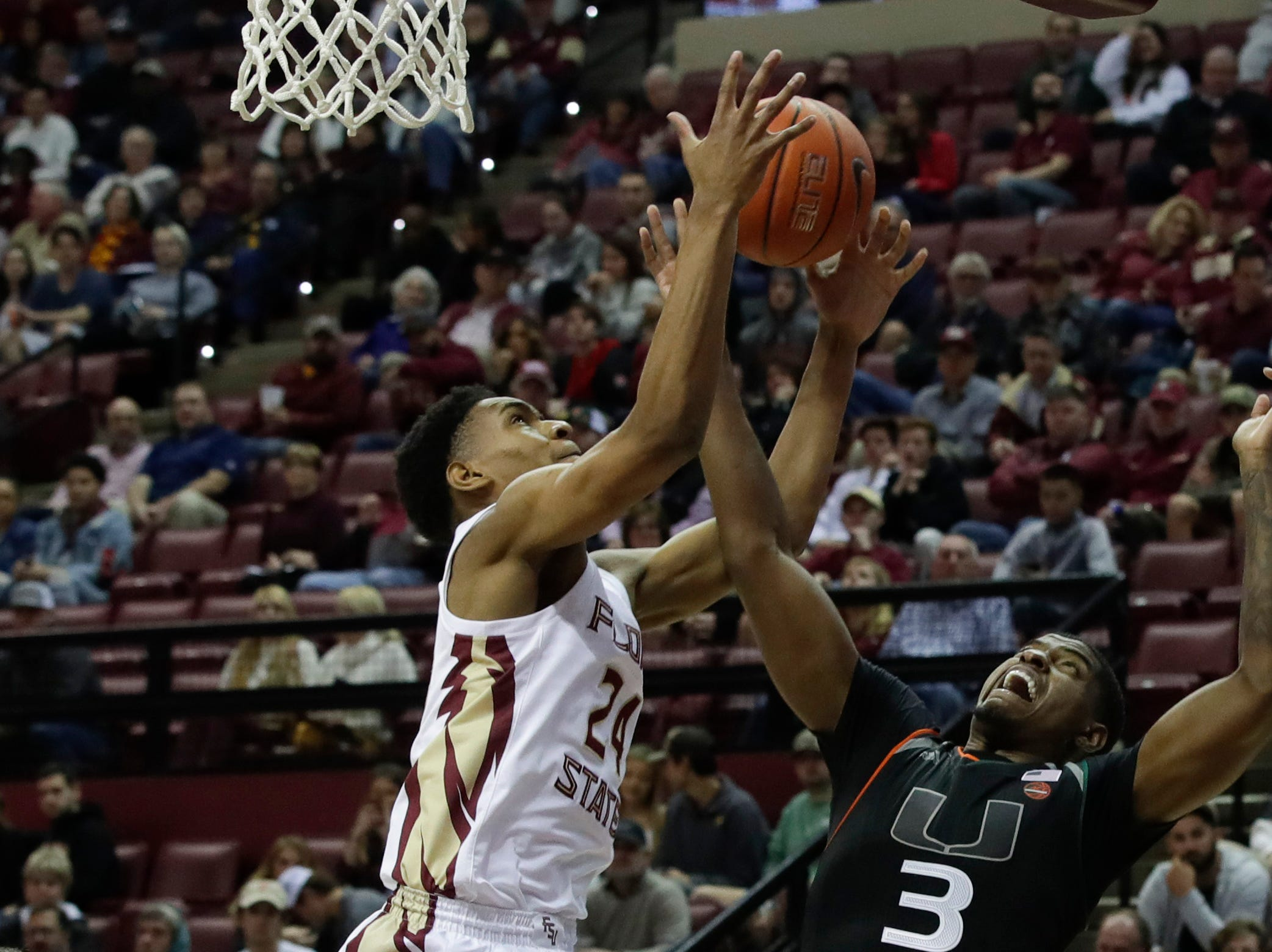 Florida State Seminoles guard Devin Vassell (24) grabs a rebound during a game between FSU and University of Miami Wednesday, Jan. 9, 2019.