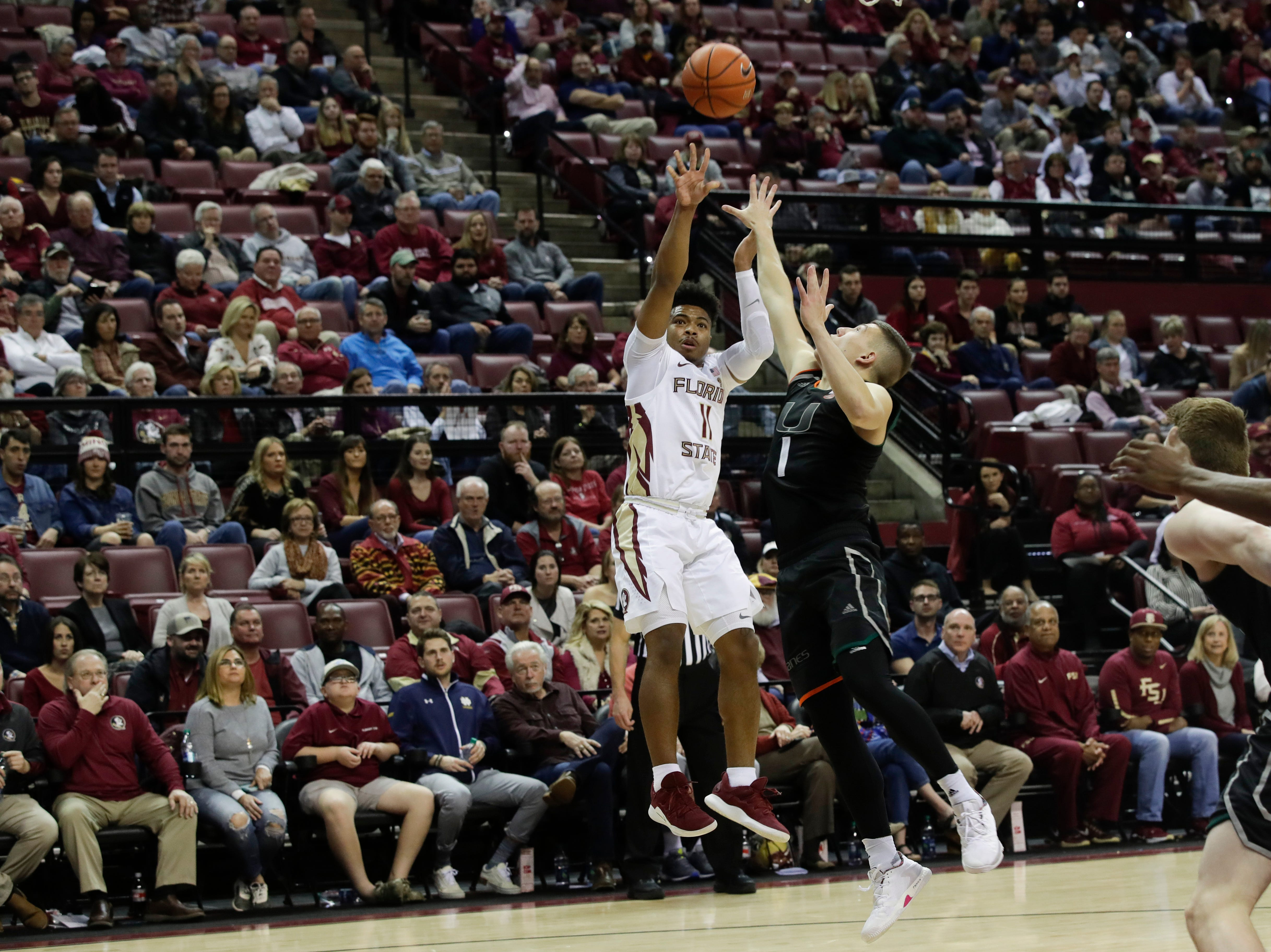 Florida State Seminoles guard David Nichols (11) shoots a jumper during a game between FSU and University of Miami Wednesday, Jan. 9, 2019.