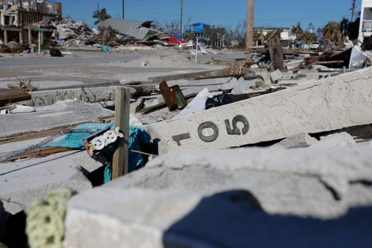 House numbers still attached to the outside wall lay on top of a pile of debris in Mexico Beach, Wednesday, Jan. 9, 2019. Hurricane Michael left the panhandle in a total disarray on Oct. 10, 2018.