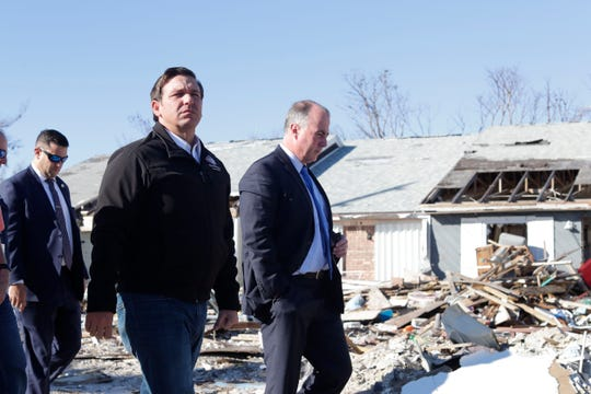 Gov. Ron DeSantis, left, walks the streets of Mexico Beach, Wednesday, Jan. 9, 2019. Hurricane Michael left the panhandle in a total disarray on Oct. 10, 2018.