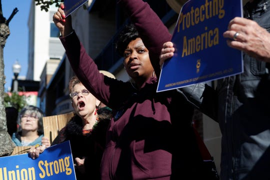 Czatka Chukes, a Federal Correctional Institution worker, chants with a group of other federal workers who rallied in downtown Tallahassee to march from the Federation of Labor and Congress of Industrial Organizations (AFL-CIO) building in Tallahassee before marching to the Florida Historic Capitol in protest of the government shutdown Thursday, Jan. 10, 2019.