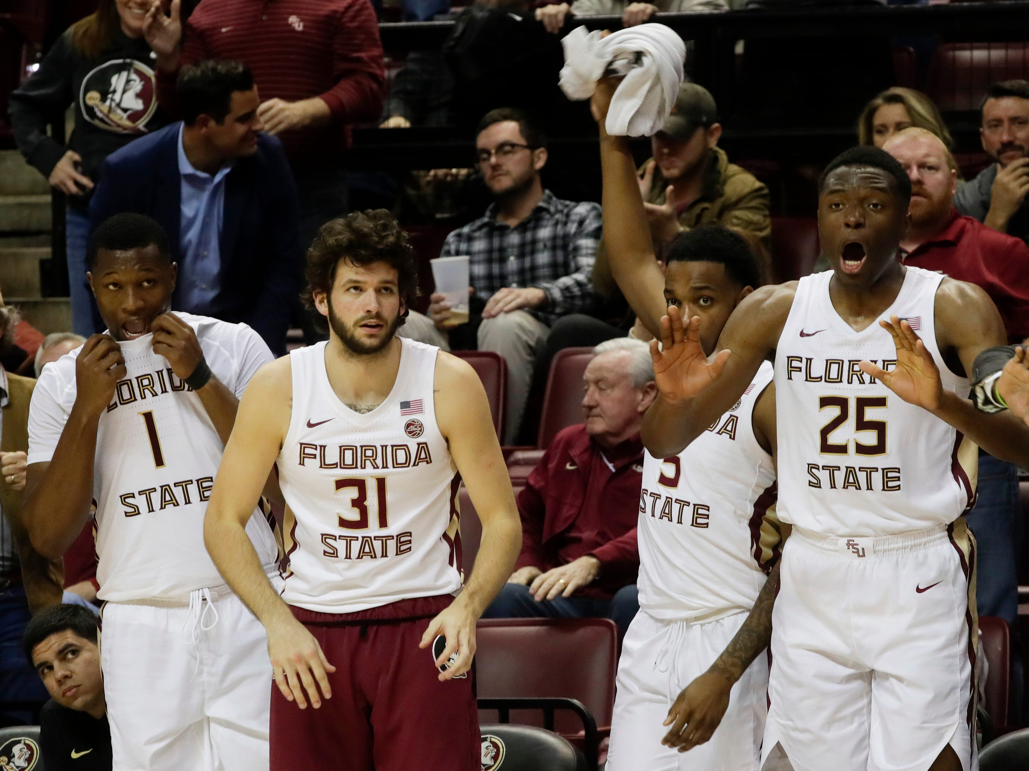 The bench reacts during a game between FSU and University of Miami Wednesday, Jan. 9, 2019.