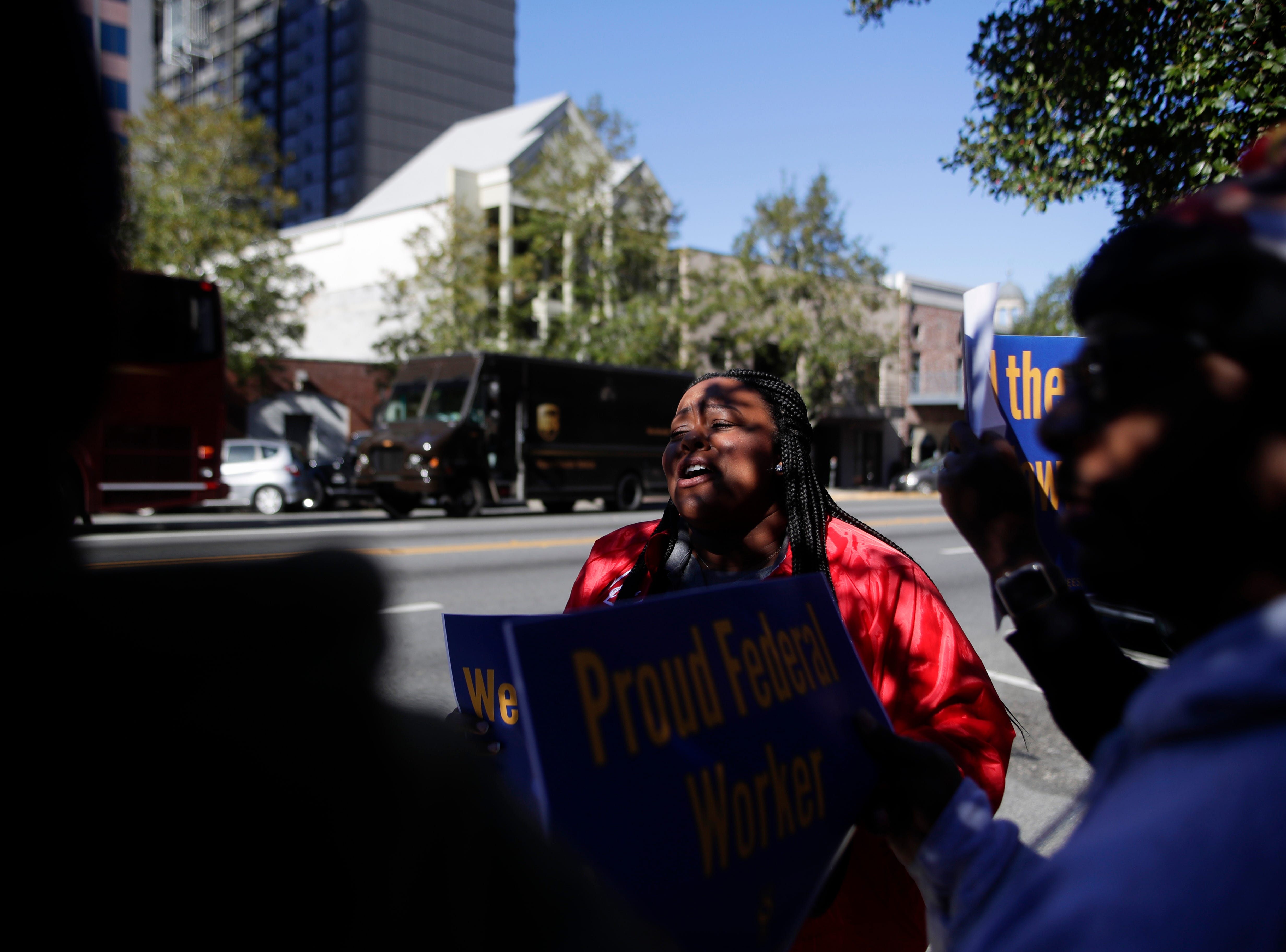 Kristan Morgan, a Federal Correctional Institution worker, leads chants among her colleagues and other federal workers who gathered to protest the government shutdown in downtown Tallahassee Thursday, Jan. 10, 2019.
