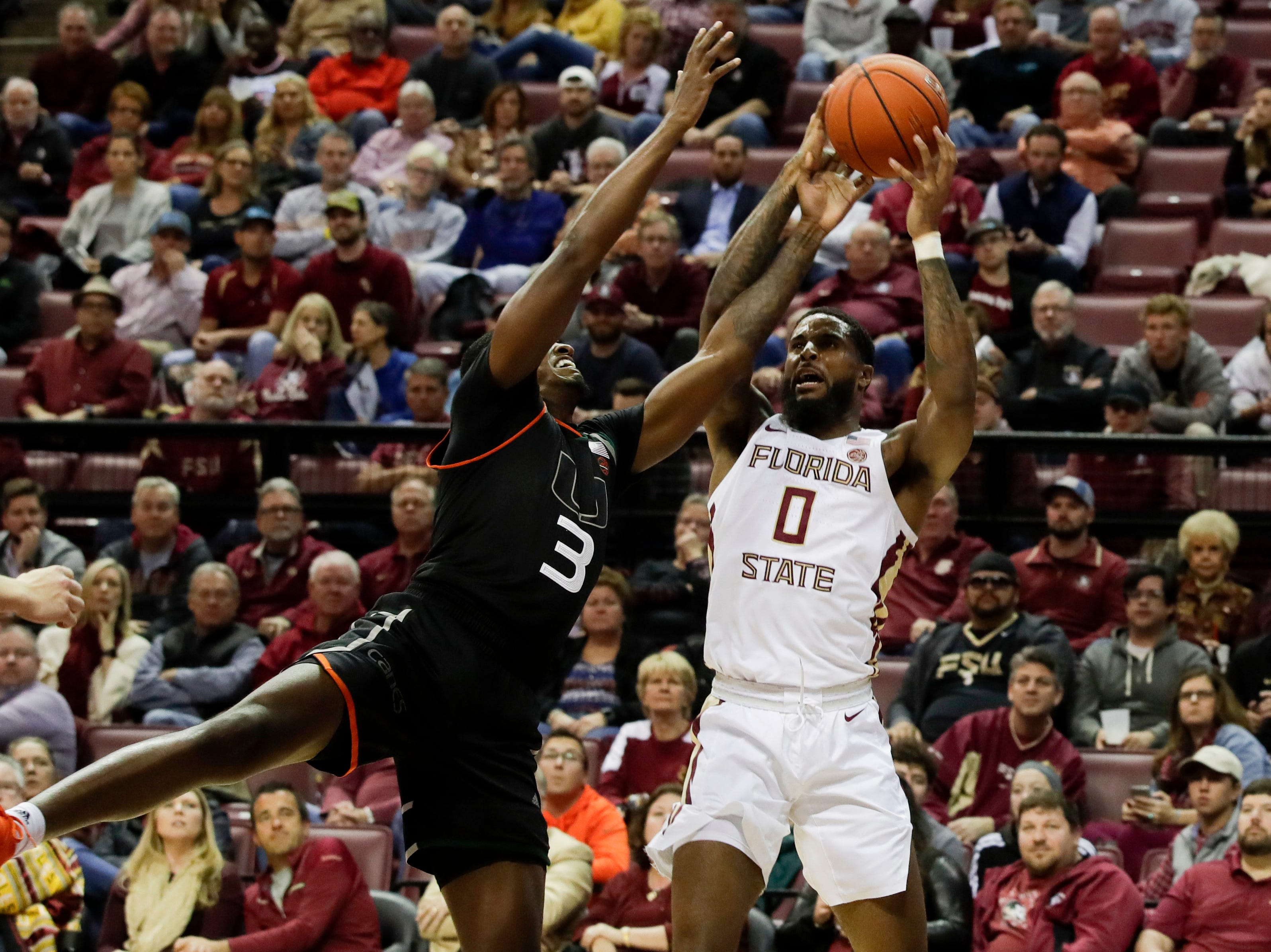 Florida State Seminoles forward Phil Cofer (0) tries to keep his possession during a game between FSU and University of Miami Wednesday, Jan. 9, 2019.