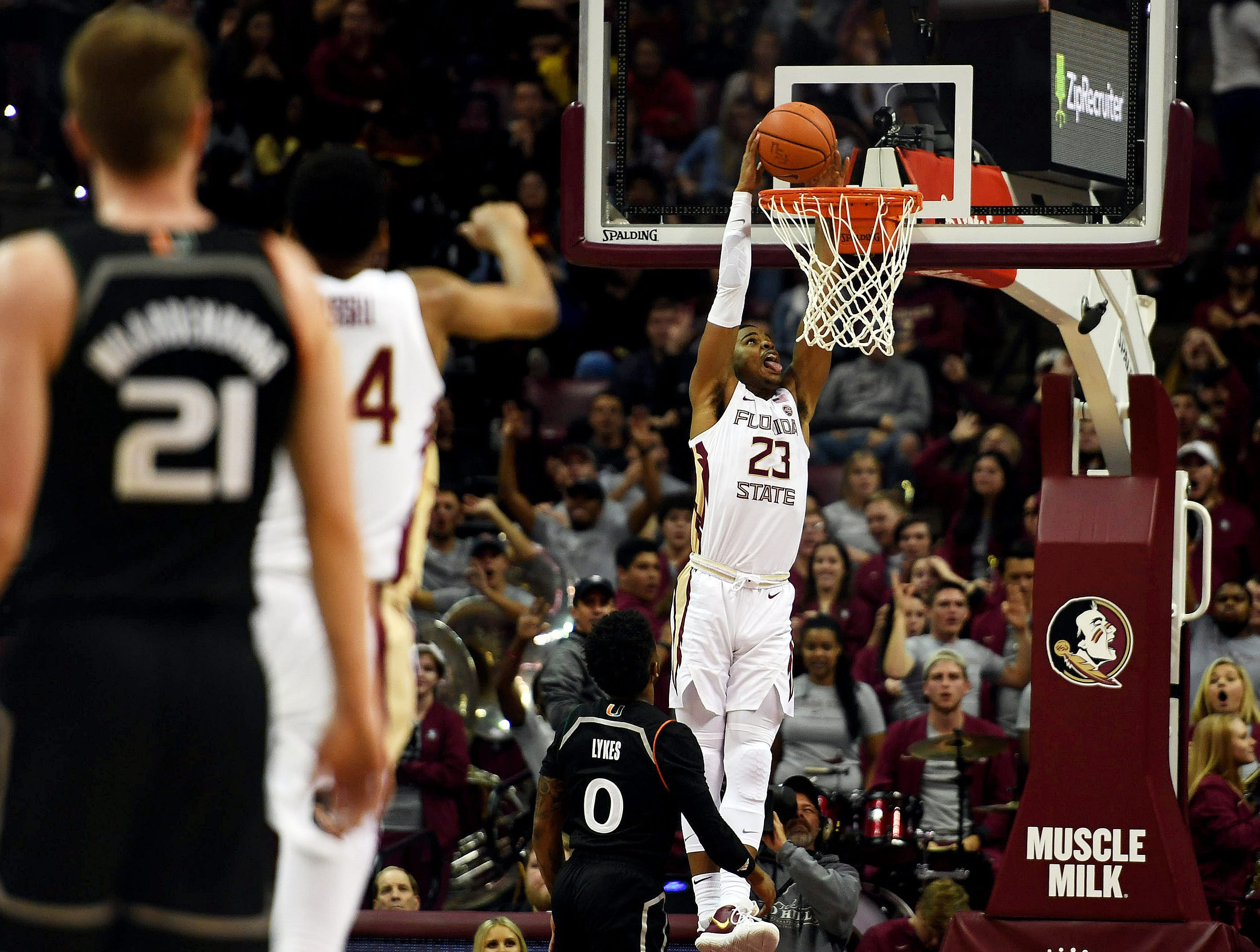 Jan 9, 2019; Tallahassee, FL, USA;  Florida State Seminoles guard MJ Walker (23) dunks the ball against Miami Hurricanes guard Chris Lykes (0) during the first half at Donald L. Tucker Center. Mandatory Credit: Melina Myers-USA TODAY Sports