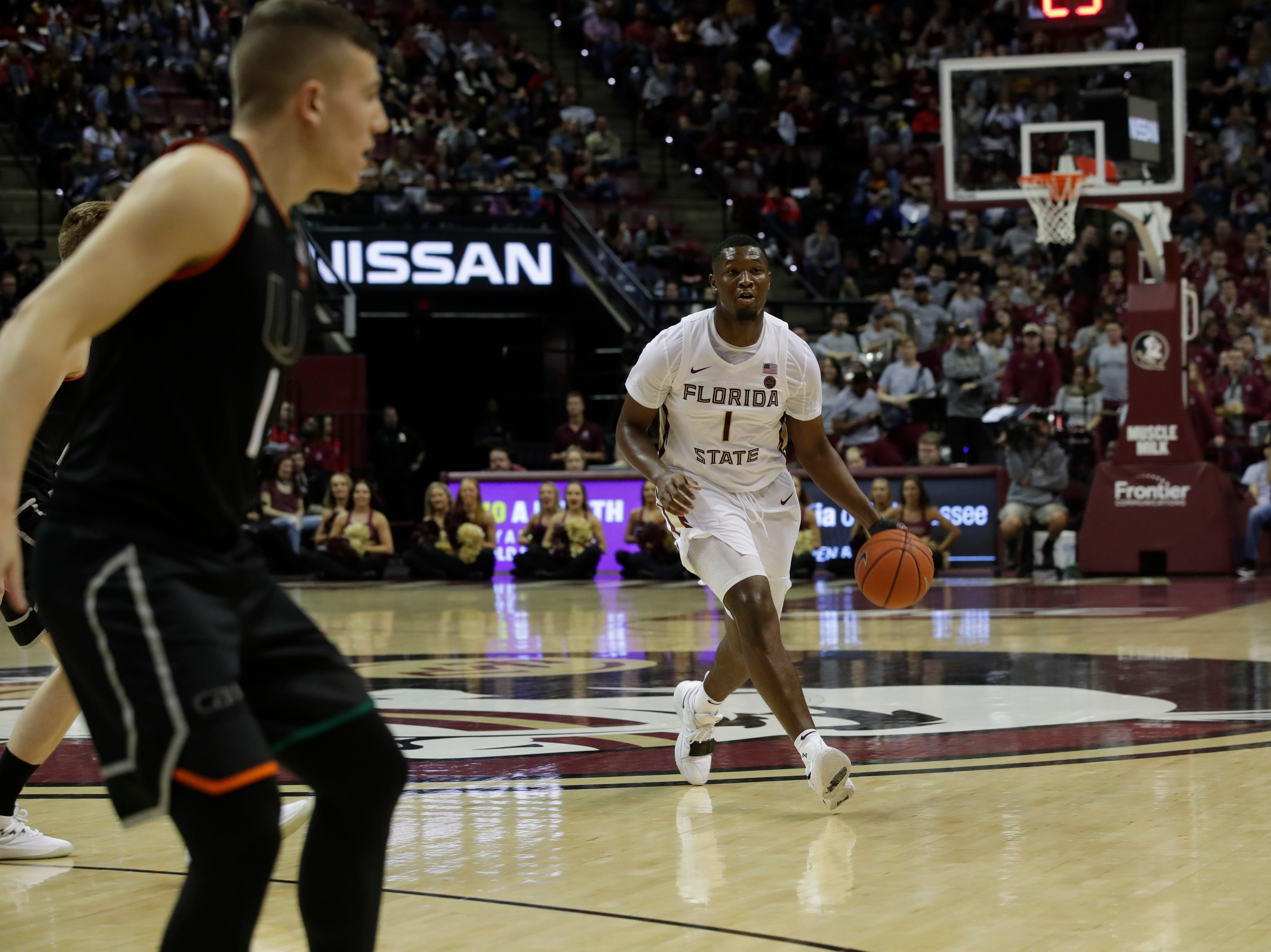 Florida State Seminoles forward Raiquan Gray (1) dribbles during a game between FSU and University of Miami Wednesday, Jan. 9, 2019.
