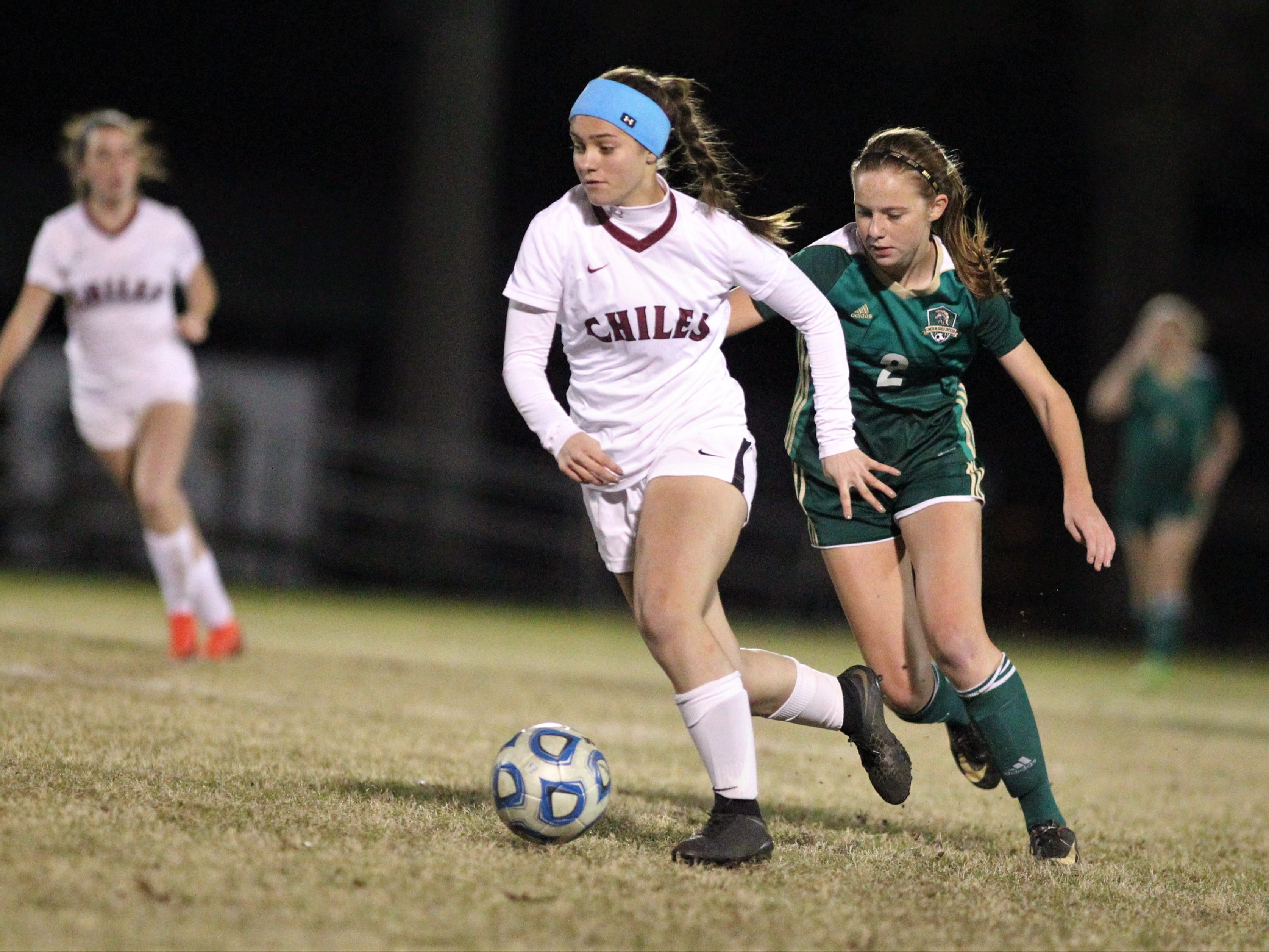 Chiles' Emily Ferris dribbles up the field as Lincoln's Chase Merrick chases. Lincoln beat Chiles 2-1 on Jan. 9, 2019.