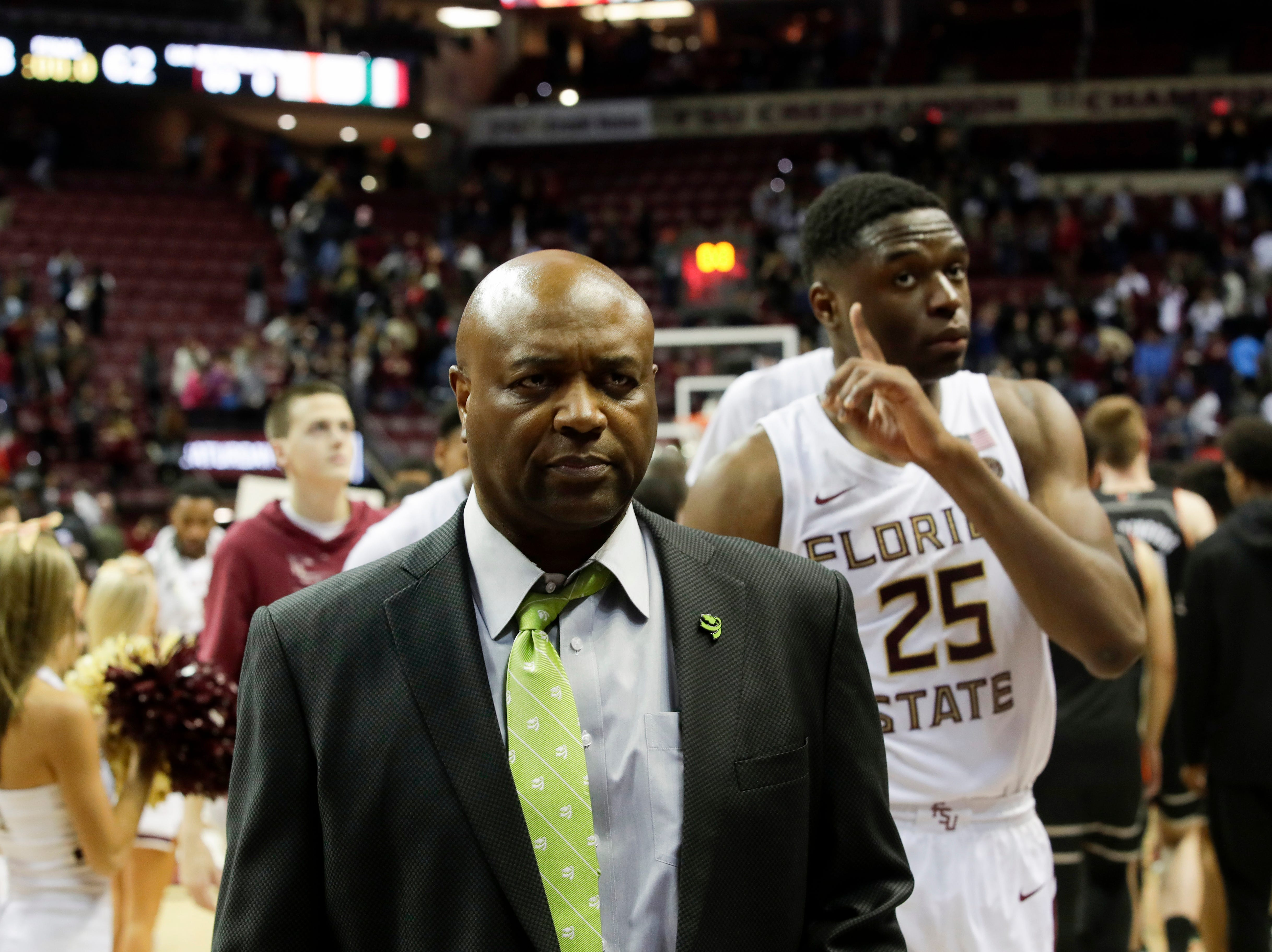 Leonard Hamilton leaves the court with his team after a win over University of Miami Wednesday, Jan. 9, 2019.