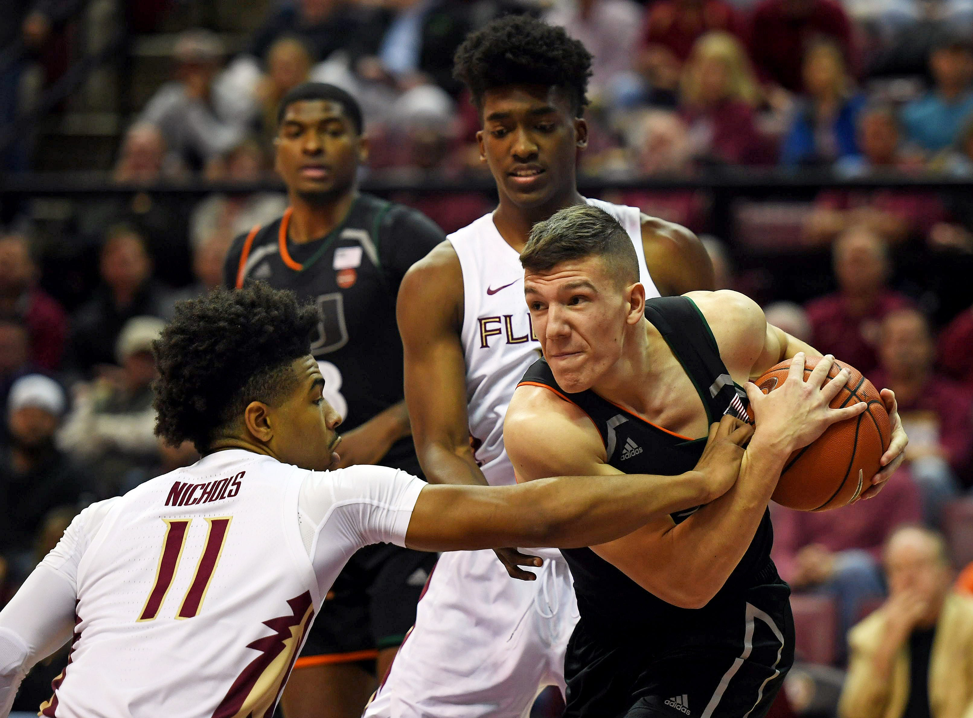 Jan 9, 2019; Tallahassee, FL, USA; Miami Hurricanes guard Dejan Vasiljevic (1) protects the ball from Florida State Seminoles guard David Nichols (11) during the first half at Donald L. Tucker Center. Mandatory Credit: Melina Myers-USA TODAY Sports