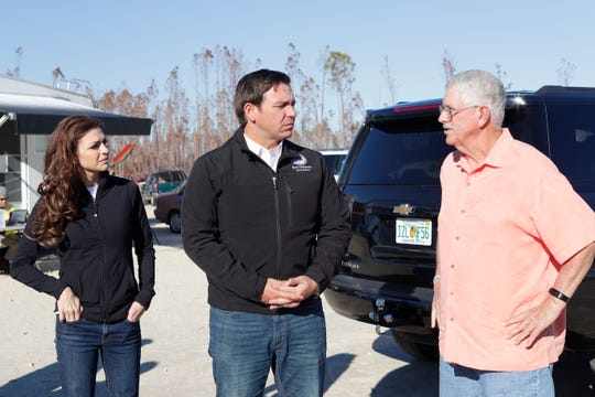 First lady Casey DeSantis, left, Gov. Ron DeSantis, and Mexico Beach Mayor Al Cathey discuss the damage in the city and what measures need to be taken in an effort to rebuild. Hurricane Michael left the panhandle in a total disarray on Oct. 10, 2018.