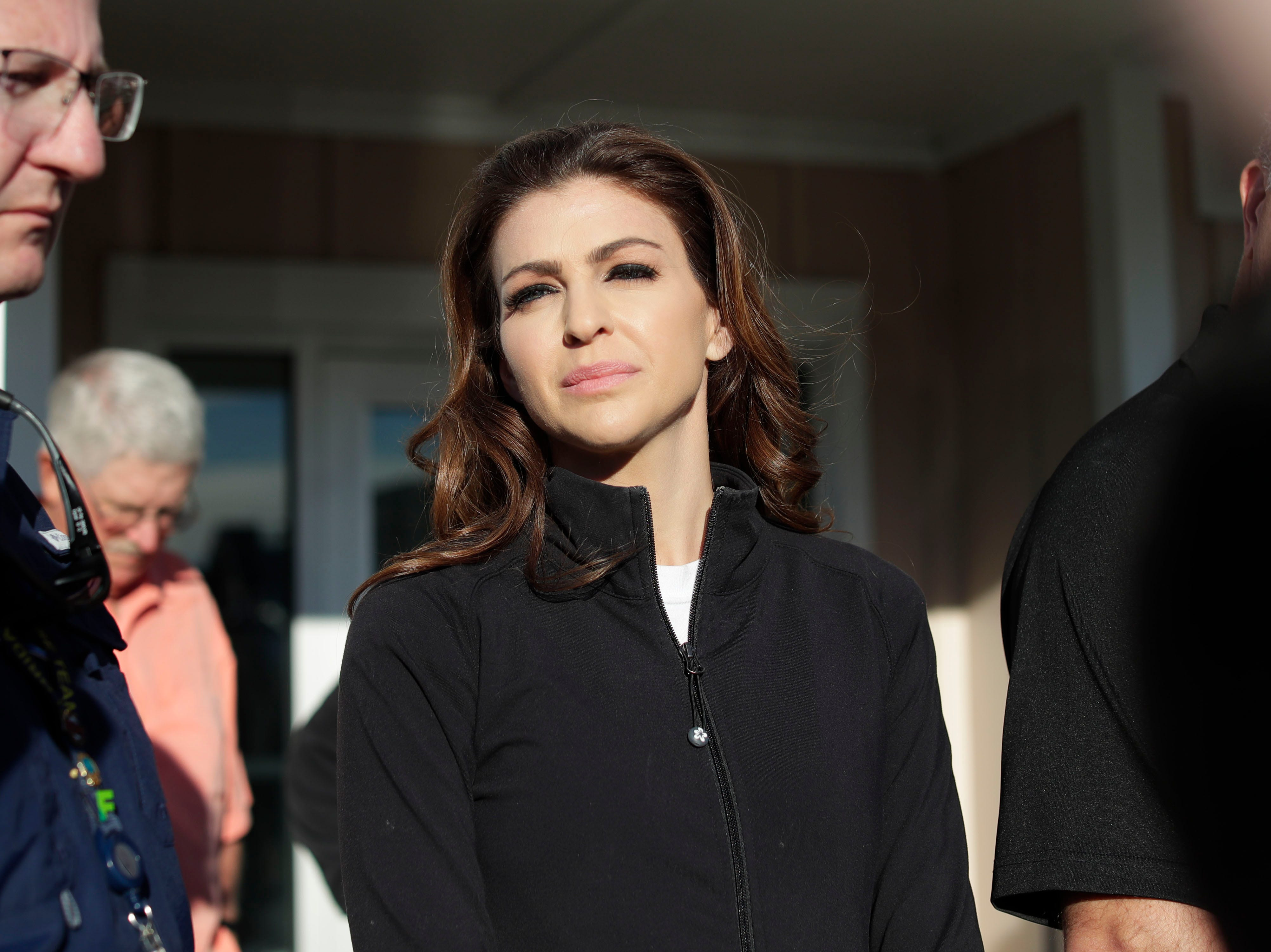 First lady Casey DeSantis stands outside Mexico Beach City Hall while her husband, Gov. Ron DeSantis, takes questions from the media, Wednesday, Jan. 9, 2019. Hurricane Michael left the panhandle in a total disarray on Oct. 10, 2018.
